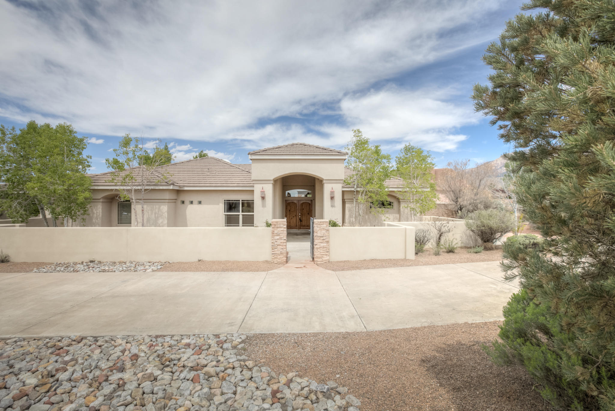 This one checks all the boxes!  Amazing single story, 4 bedroom, swimming pool and close to La Cueva High School.  Pull up into the concrete Horseshoe Drive and park in the 3 car, fully finished garage.  Nicely landscaped courtyard welcomes guests.  Spacious master with backyard access to the pool and hot tub.  expansive concrete work makes this backyard usable and easy to care for.  Home has 3 full bathrooms.  New paint and carpet throughout make this ready for a quick close.  Call or come by today!