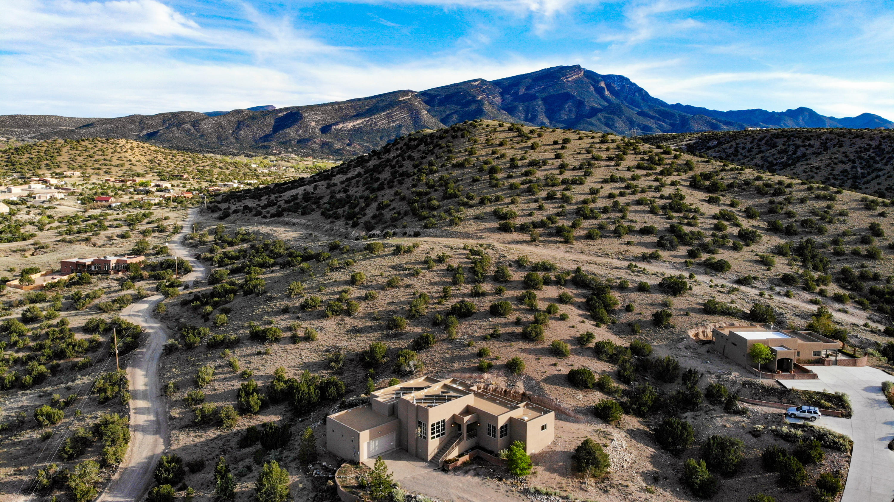 Beautiful custom home on 2.35 acres w/ expansive views of the Jemez mountains, western mesas & Cabezon Peak. The many windows & skylights fill the home w/ natural light & the raised beamed ceiling creates an inviting, open feeling. Custom features include lighted nichos, custom gas fireplace & the living area is wired for surround sound. The kitchen features solid surface counters, solid hickory cabinets, glass tile backsplash, island w/ eating area, stainless steel appliances (Asko, Dacor, Electrolux), reverse osmosis filtration system & opens to the large covered patio. The large separate master features an en suite bath w/ jetted tub, dual shower, double vanity & large walk in closet. The home also features aux 3kV solar power, refrigerated air/combo unit & large garage w/ storage.