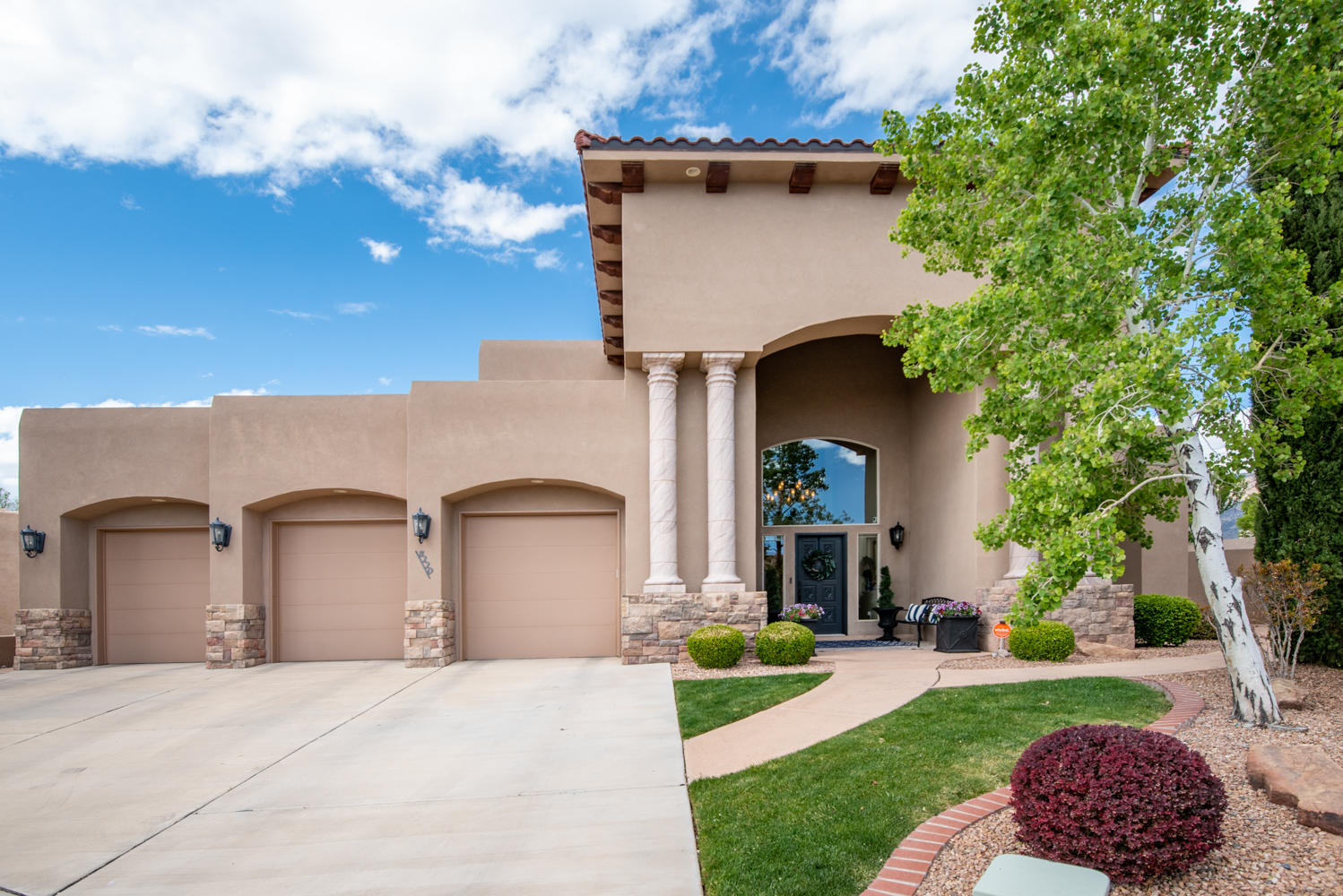 Stunning custom Panorama home, full of natural light! End of cul-de-sac in Albuquerque's best schooldistrict. Built in 2006, updated in 2011. Phenomenal open floor plan. Kitchen, breakfast nook, andlarge island all connect to great room and formal dining. Media room, home office, and formal livingroom complete the main floor. Spacious master and master bath, large second bed with en suite bath,Jack-and-Jill bed/bath combo, laundry, and small 5 th bedroom on second floor. White designer kitchenin 2011, custom light fixtures throughout, hardwood and tile flooring. Beautifully landscaped yard withlarge gated pool, auto cover and in ground hot tub, 10x17 size trampoline. Breath taking view of Sandia Mountains!  Pool size 16' x 33'