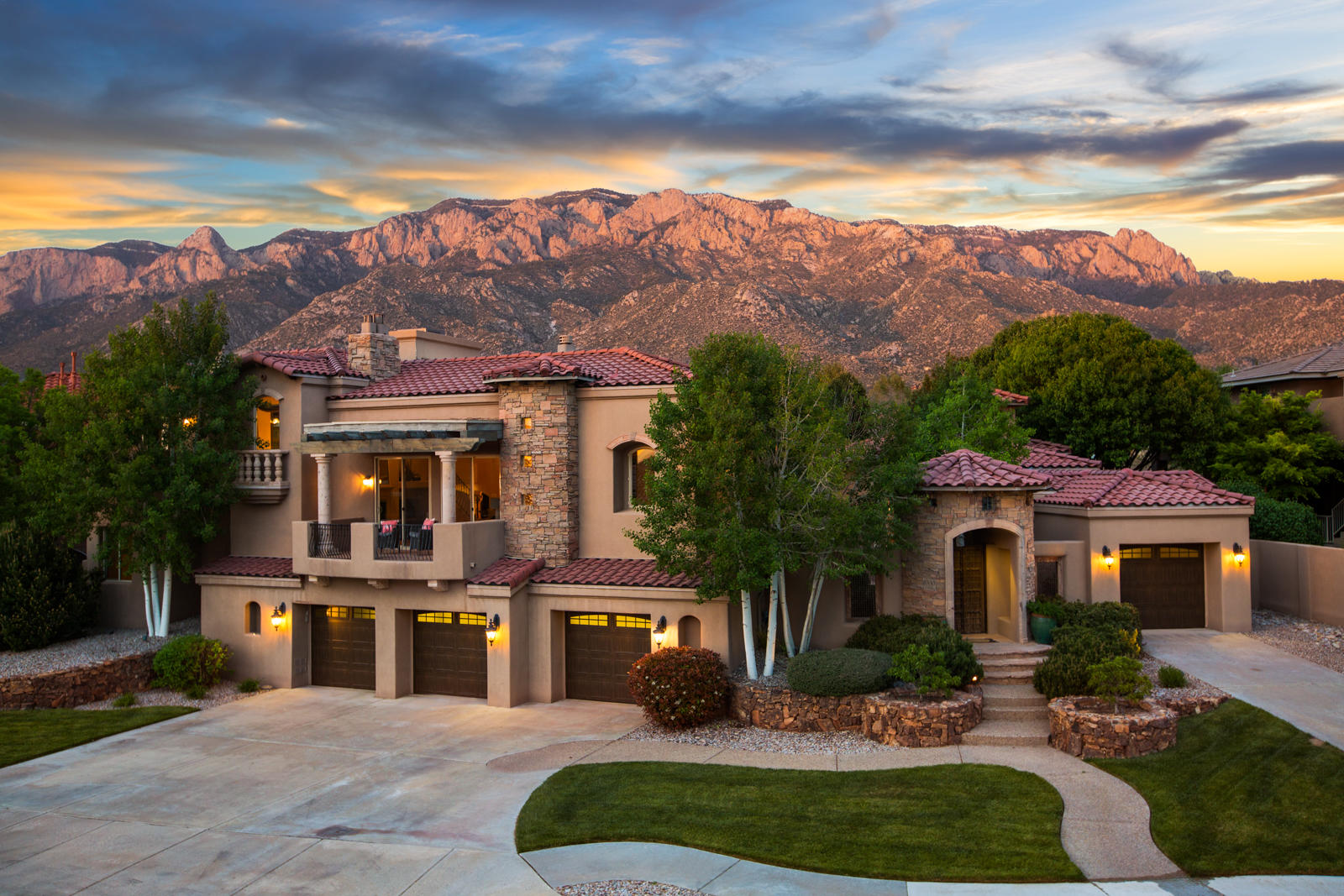 This masterfully built Primrose Pointe home was inspired by the Mediterranean architecture found in Tuscany. Designed and built by Koinonia Homes, this home was the Parade of Homes Award Winner. This spectacular residence is grand in scale yet comfortable. Designed around a beautiful central courtyard, the home and guest house overlook beautiful gardens and spectacular views of the majestic Sandia Mountains & city lights. Reclaimed architectural elements, cantera stone, timeless travertine, rich granite, handcrafted iron, and beautiful woodwork define this great home. Attention to detail is everywhere you look. Inviting floorplan offers 2 master suites and a third bedroom in the main house, and a fully appointed guest house with another bedroom suite, kitchenette, living, dining & garage.