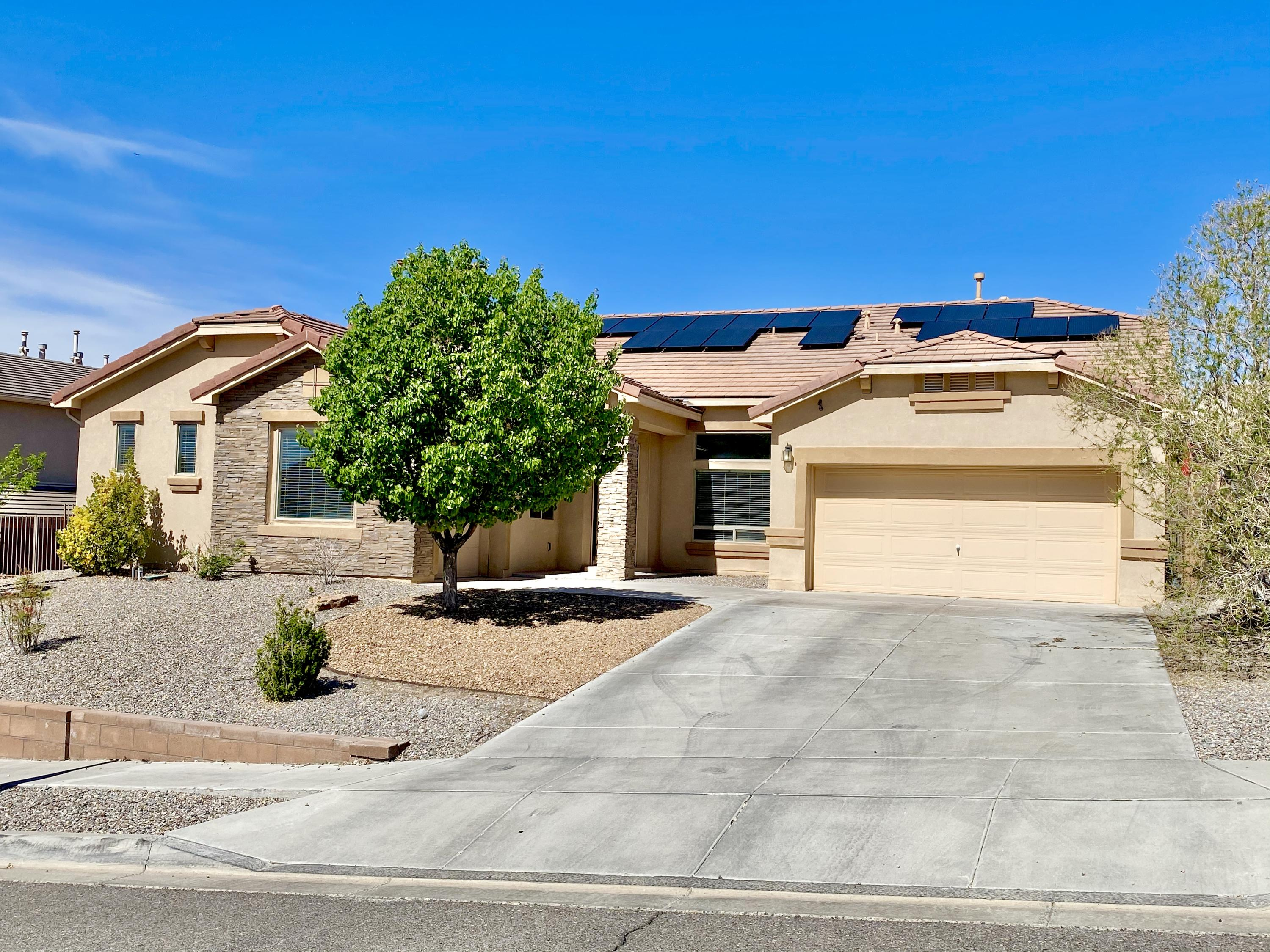 **SELLER TO CREDIT $5,000 PAINTING/LANDSCAPE CREDIT** Make an appointment to see this elegant 1 story home with recently installed solar and NEW CARPET! No Solar Lease, Average electric bill with Solar $8! The most coveted 1 story floor plan in the neighborhood, this home has 4 spacious bedrooms, 3 bathrooms, 2 car garage with BONUS room that could be converted into a study, motorcycle/exotic car garage, office etc! Brand new landscaping in front including an automatic watering system.  With double pane thermal insulated windows, double ovens, HUGE soaking tub, Samsung Family Hub fridge, a wrap around owner's suite closet & a large enclosed yard with with peaceful waterfall! Close to large park & shopping.*can do a fast closing