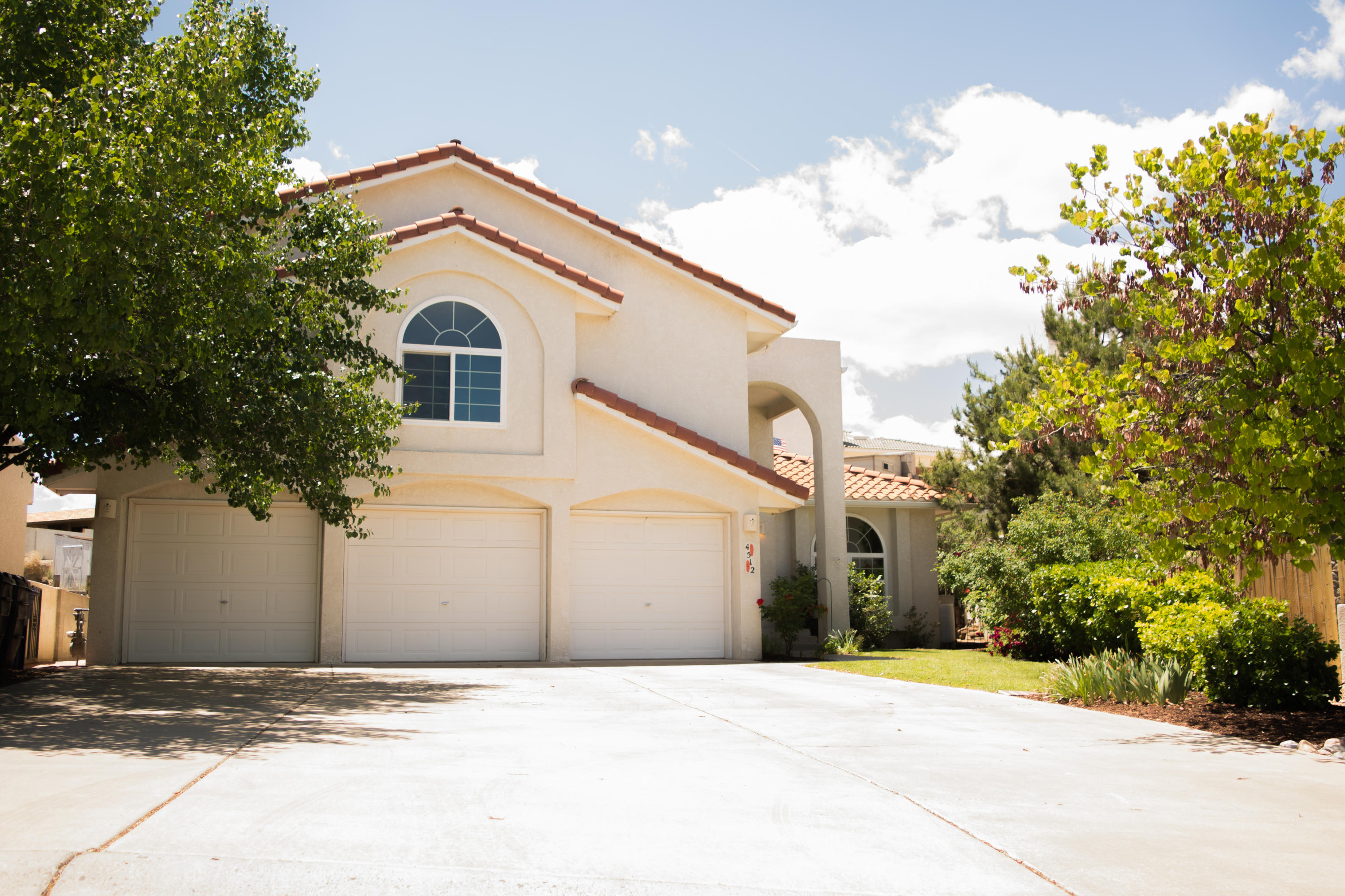 Beautifully Updated Taylor Ranch Gem! Quiet cul de sac. Stunning Paradise of Flora & Fauna - Large quarter acre lot. Bright, open, soaring ceilings, newer kitchen, windows, doors, HVAC, roof underlayment & paint! 6 bedrooms, 3 Car Garage + 6 car parking. One of a kind irrigated yard overflowing with established shade & fruit trees, Lady Bank's rose vines adorn trellis patio, terraced beds, walkways, flowers & greenhouse! Major kitchen renovation doubled size and yielded a multi-chef's work space, Sollid Brand Cabinets, induction downdraft 5 burner cooktop, inset counter depth frig, two sinks, Jenn-Air ovens. Stunning mountain views from Owner's suite. Large bath, dbl sinks, separate jetted tub/shower. Great location near Montano Plaza & Coors! 5 min to I-40, 20 to downtown.