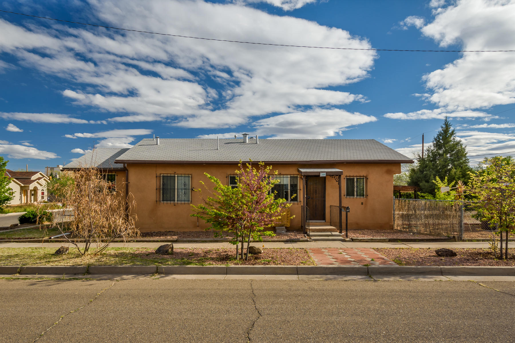 This is a beautiful 3-bedroom home located near the Downtown area of Albuquerque. Wood floors throughout! Adobe and block walls! Lots of storage space.Large corner lot. Plenty of room to park an RV or extra vehicles in back  yard.  Home can easily be converted BACK INTO a Duplex. (was a duplex at one point) New vinyl windows! Roof is only approx 14 years old. Home has a large crawlspace underneath! (great for storage/basement area) Property being Sold AS-IS, WHERE IS.