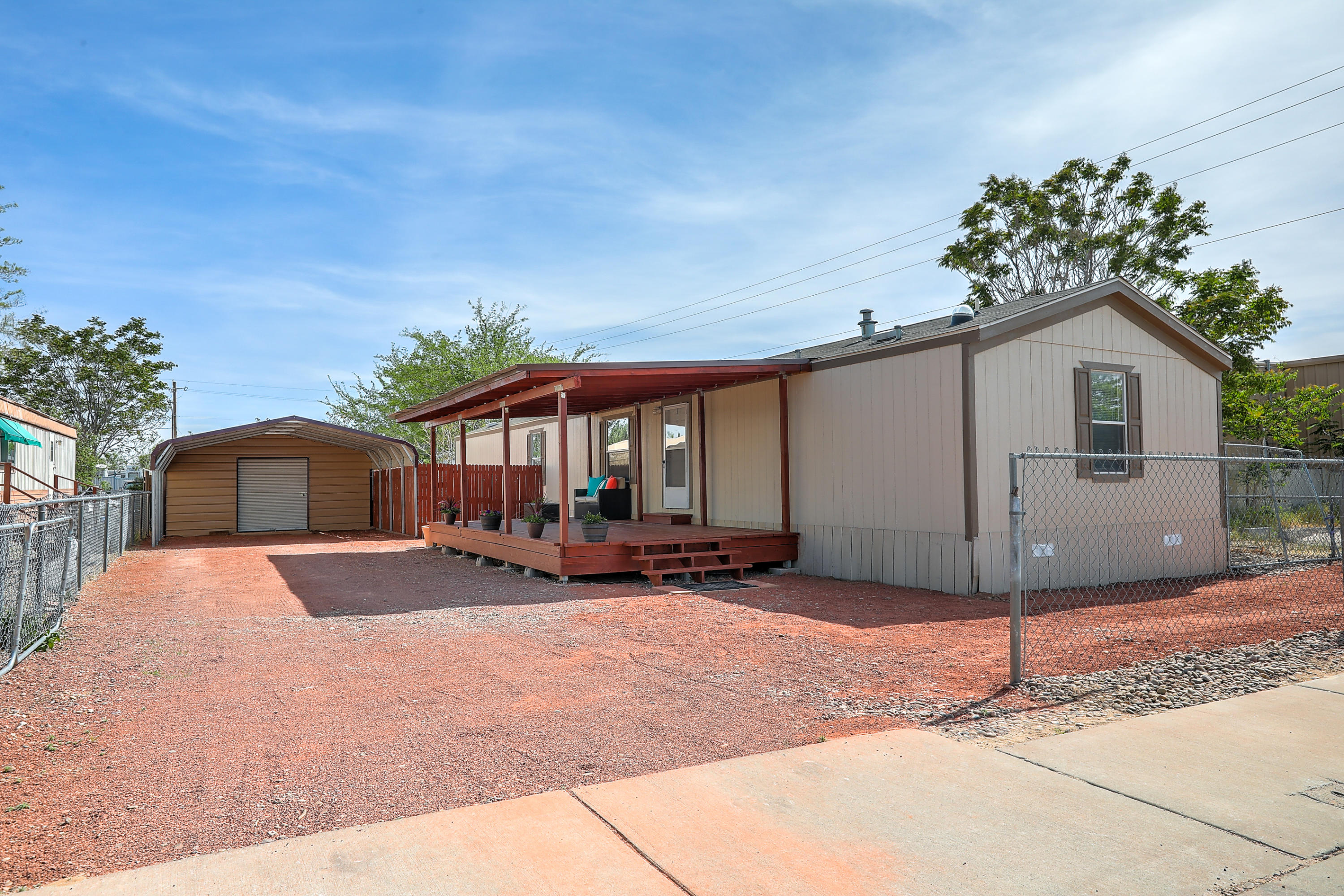 Great LOCATION Near Paseo/I-25! This trailer is a MUST SEE! It was constructed in 2011 and is a perfect size at 1300sq.ft. 3 bed w/2 full baths. As you pull in you'll notice the Beautiful Covered Patio that creates a Cozy Outdoor Space, perfect spot Entertaining & Grilling.  Front Entry Way leads to an Open Floor Plan with Living Room flowing into the Kitchen and Dining Room.  BIG Master Bedroom w/ Large Closet, Master Bath has Separate Sinks, Shower and Garden Tub.  On the other side are 2 additional Bedrooms and Full Bathroom.  Has a nice sized carport for 2 cars and additional storage in backside of carport!  Located at the end of a Cul-de-Sac, perfect for entertaining! Setup an Appt. today! This ones Move-in Ready!