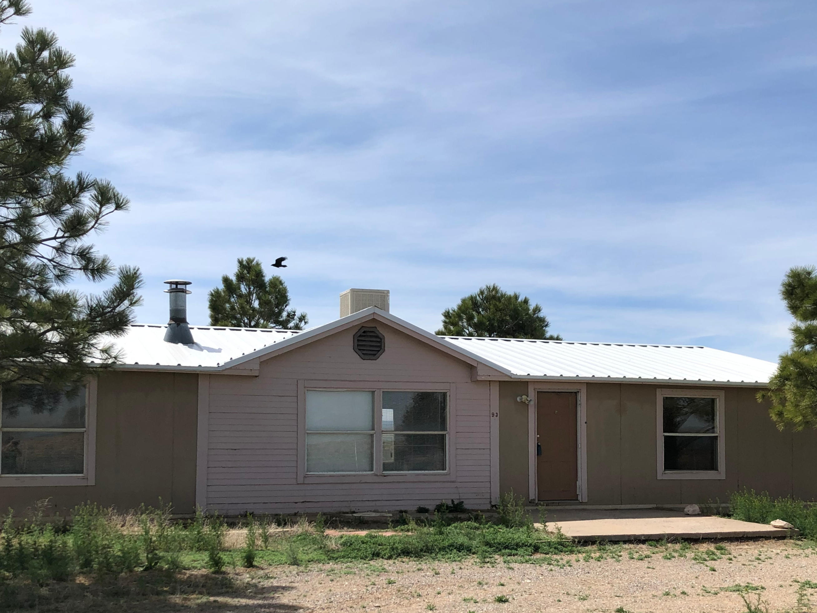This manufactured home on 10 acres located in Santa Fe County, New Mexico offers mountain views, wide open spaces and the peace and quite of country living. The home is 3 bedrooms and 2 baths and a large family dining area. This is your easy 30-minute commute to Albuquerque or about an hour to Santa Fe.