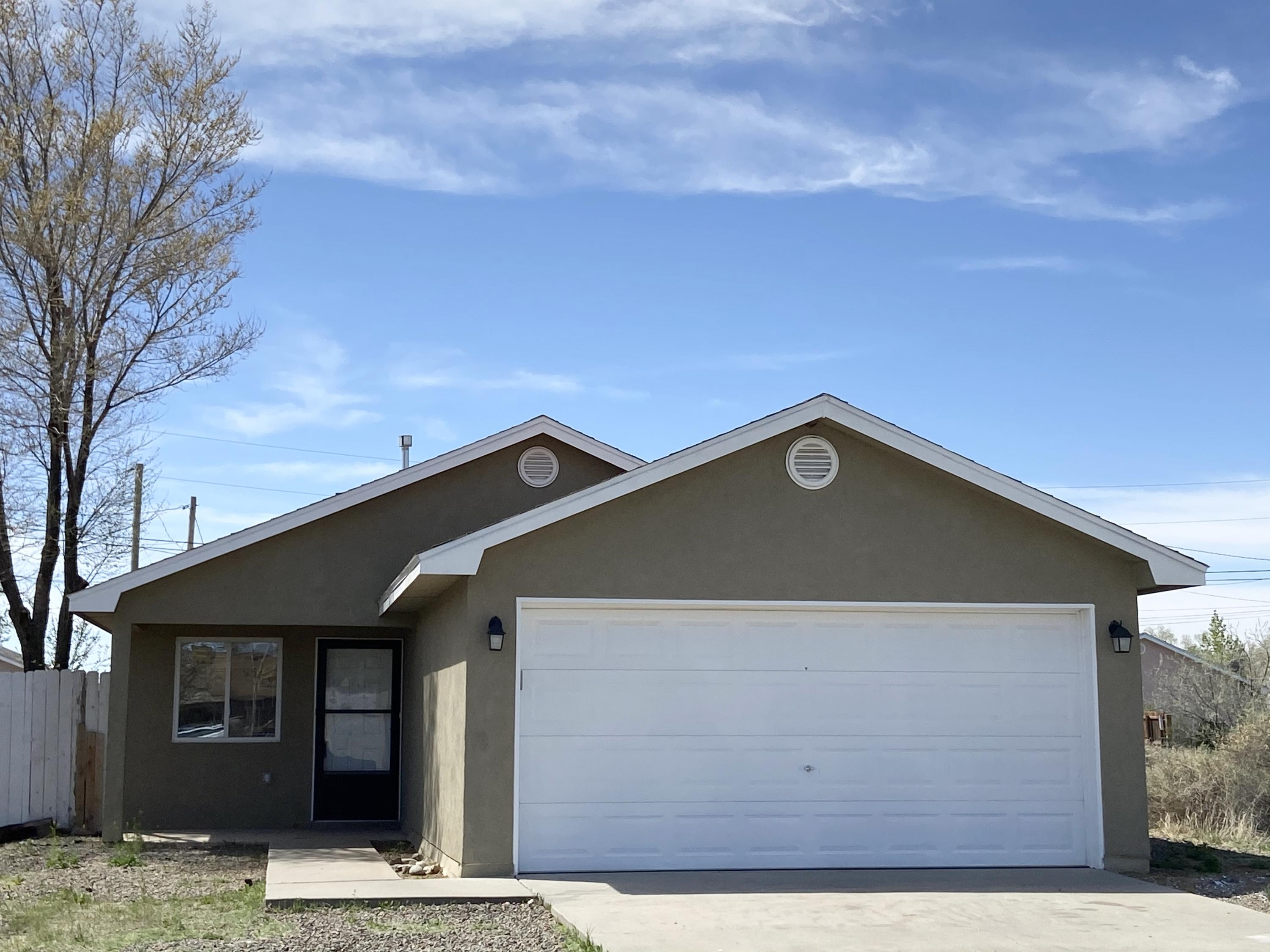 Cute 3 bedroom 2 bath, 2 Car Garage in Moriarty.  Newer carpet.  Freshly painted, open kitchen with tons of cabinets and countertop space. On paved road.  Easy access to I-40.