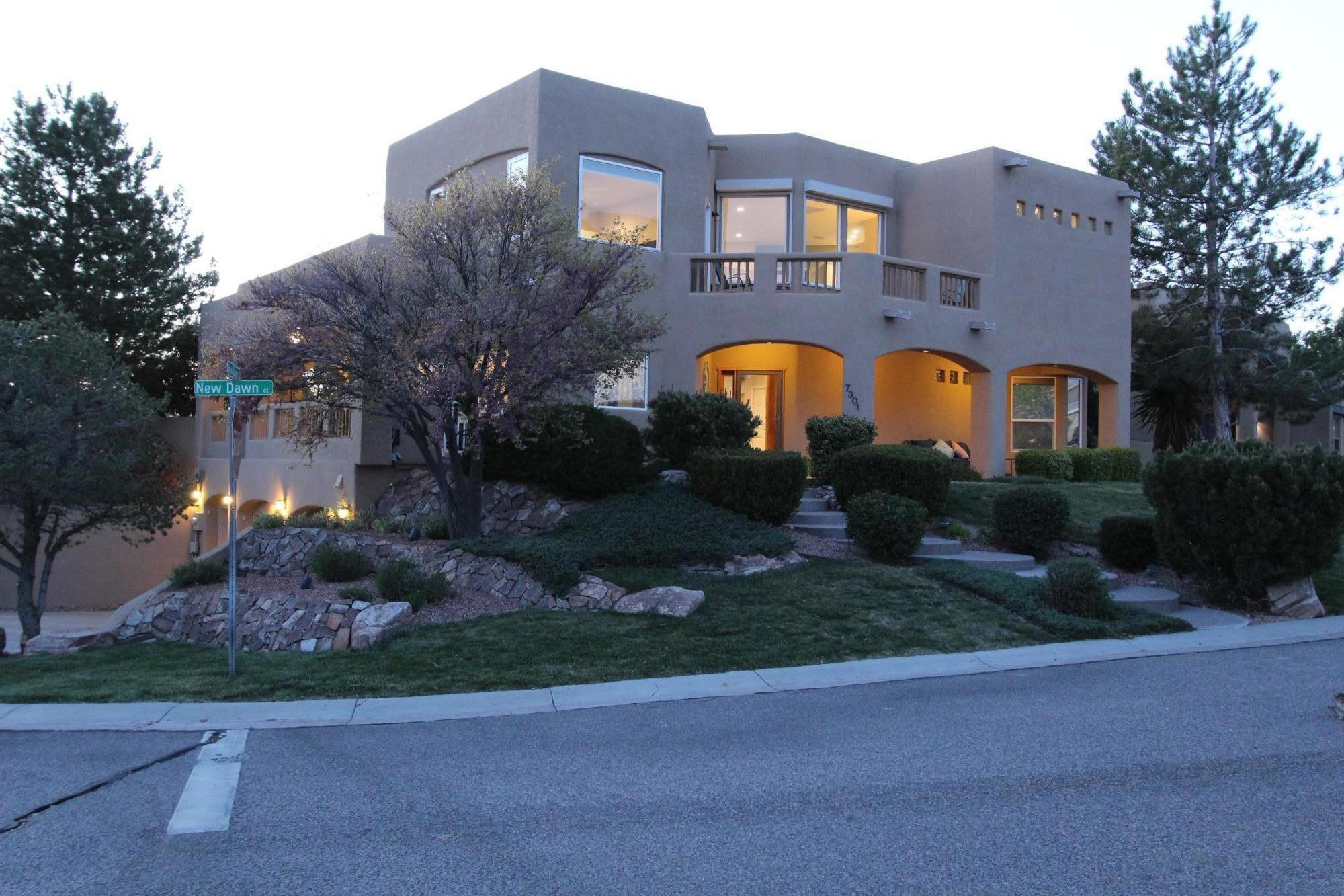 This Sparkling SW Contemporary Home  features fantastic sunrises & mountain views. Full of natural light. Enjoy the views from the spacious kitchen with large island/with seating. Kit.Aid appliances, gas cook top, granite counters, breakfast nook and balcony. The Great Room has new finishes and gas log fire place, vaulted ceilings and wall of windows to lush, intimate BY. Formal DR looks out to BY. Master Suite enjoys FP ,private balcony, jetted tub, shower/double lavs,large walk in closet with washer/dryer. New Guest suite has full bath and private balcony. Two more bedrooms on main floor. Office/loft has built incoffee bar/sink. Oversized  1200 sq. ft. 3 car garage with storage/workshop and half bath.  Beautiful windows throughout. Laundry Rm on main. This Home Shines!