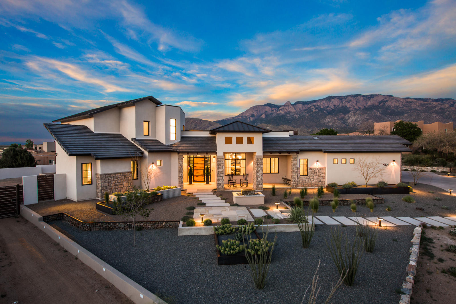 Incredible custom home with exquisite finishes that are both contemporary and timeless. Located in Ventura Estates on a .89 acre lot with STUNNING views of the mountains. This completely custom home features 4 spacious bedrooms, 4.5 baths, oversized 3 car garage, entertainers dream kitchen, open concept with indoor/outdoor living, temperature controlled wine wall and so much more! The gorgeous master bedroom on the main floor includes a seating area, huge master bathroom with custom cabinetry, stand alone tub, walk in shower, and walk in closet which leads to the laundry room. The kitchen features gorgeous Marc Sower custom cabinets, quartz countertops, top of the line appliances and built in eating area! Breathtaking views from the back patio to enjoy in this oasis backyard.