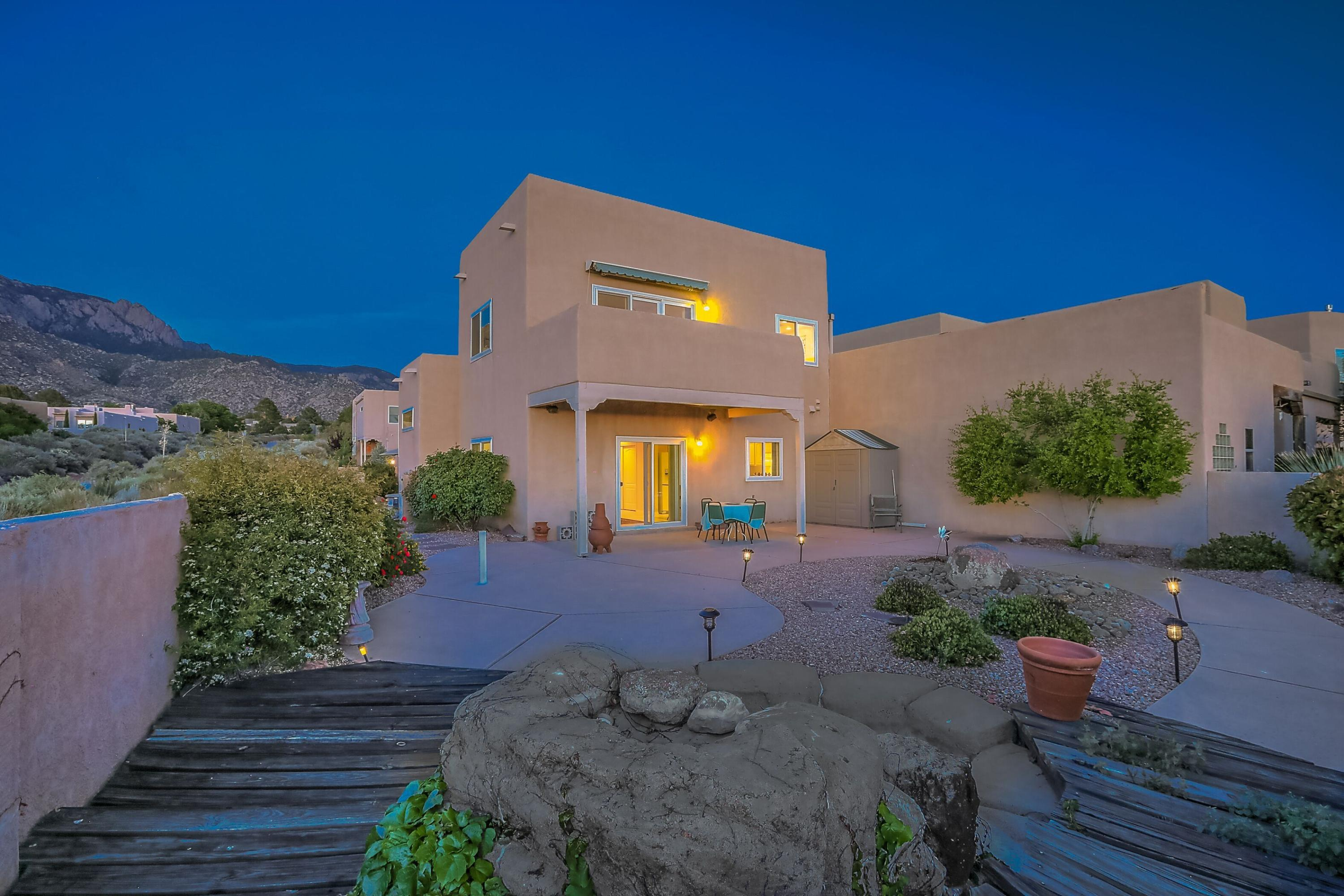 If you are looking for a low-maintenance, affordable home in an excellent school district, close to hiking & biking trails AND with amazing city and mountain views, here it is!  This two story home sits on the end of a cul-de-sac & features a modern, open floor plan w high ceilings & abundant natural light.  You will love the rough hewn beams in the connected living & dining area & the curvilinear wall of windows with views of the Sandia Mountains.  One bedroom and a 3/4 bathroom are on the main level, perfect for anyone who hates stairs.  The owners suite upstairs features a balcony w forever city views, plus a walk-in closet, garden tub & sep shower.  Another bedroom & bathroom are also upstairs.  With abundant storage, a newer HVAC system, & newer windows, be prepared to fall in love.