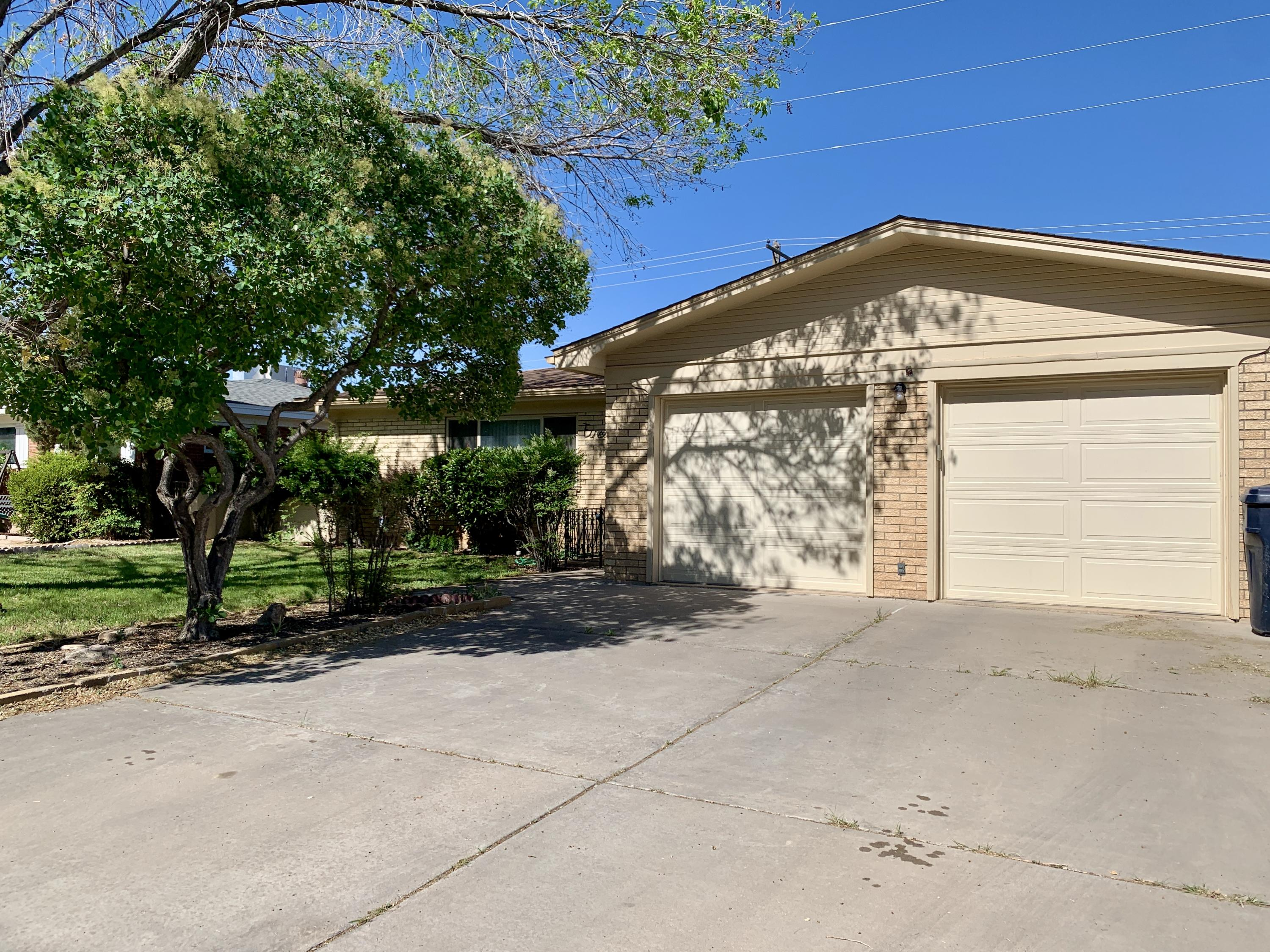 Come see this charming brick home centrally located near shopping and just minutes from UNM.  This great home features beautiful recently refinished hardwood floors 2 living areas, master suite with claw foot tub. Updated windows and new roof still under warranty round out this move in ready home.