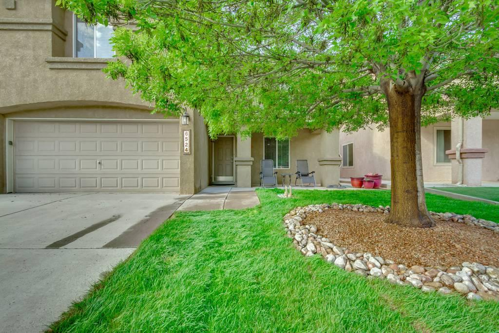 This beautiful home sits on a lot that provides wonderful unobstructed views and privacy, great for entertaining! Upstairs are 5 bedrooms, 3 bathrooms and a loft. The master suite is elegant and private (away from the other bedrooms), the master has a dbl-sized walk-in closet with plenty of space for all your needs. Downstairs is an office/den and a half-bath. One of the highlights of this home is the open concept. The owners removed all the downstairs carpet replacing it with stylish wood vinyl. This spacious home has a stainless package which conveys; dishwasher, gas stove w/ dbl oven and a dbl-sized fridge, great for a large family or entertaining!