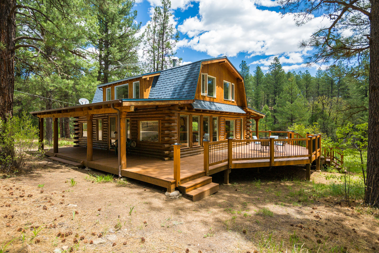 Step into this enchanted handcrafted Log Home with guest cabin! Rare once in lifetime offering. Breath in pine scented air. Hear the crow caw high above the canyon. Original owner & creator.  One of a kind, private sanctuary set amidst 11 acres of 'end of the road' solitude bordered by thousands of acres of National Forest in 4th of July Canyon, Manzano Mountains. A creek runs thru this lush getaway featuring a hand crafted, meticulously designed and maintained 3 bed Log Cabin Home, lovely Guest Cabin, restive front porch overlooking the creek plus a serious Workshop, heated & A/C. This could be your full time home or weekend retreat getaway; 1 hr 15 min from Big I of ABQ. Work from home; Hi Speed Internet. Scenic hiking, wildlife and natural beauty abound. Open Sunday 5/24 by appointment