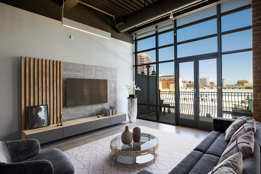 One of a kind custom Build-Out at The Lofts at 100 Gold! This 2 bedroom, 2 bath will impress you. Recently refinished 3 1/4 Solid Maple Hard Wood Floors, Maple Cabinets, WOLF Range, Sub-Zero Refrigerator, Towel Warmer, Samsung Washer and Dryer, floor to ceiling windows, and TWO balconies allow for luxury living. Enjoy the convenience of Albuquerque's Downtown Area. Minutes to hospitals, the University of NM, Kirtland Air Force Base, Old Town, Rail Runner, and the city's new Rapid Transit system. Minutes from the ABQ BioPark, Tingley Beach, Open Space, the Albuquerque Country Club, International Sunport, and right across the street from the Silver Street Market grocery store and Century 14 Theater. Welcome to 100 Gold!