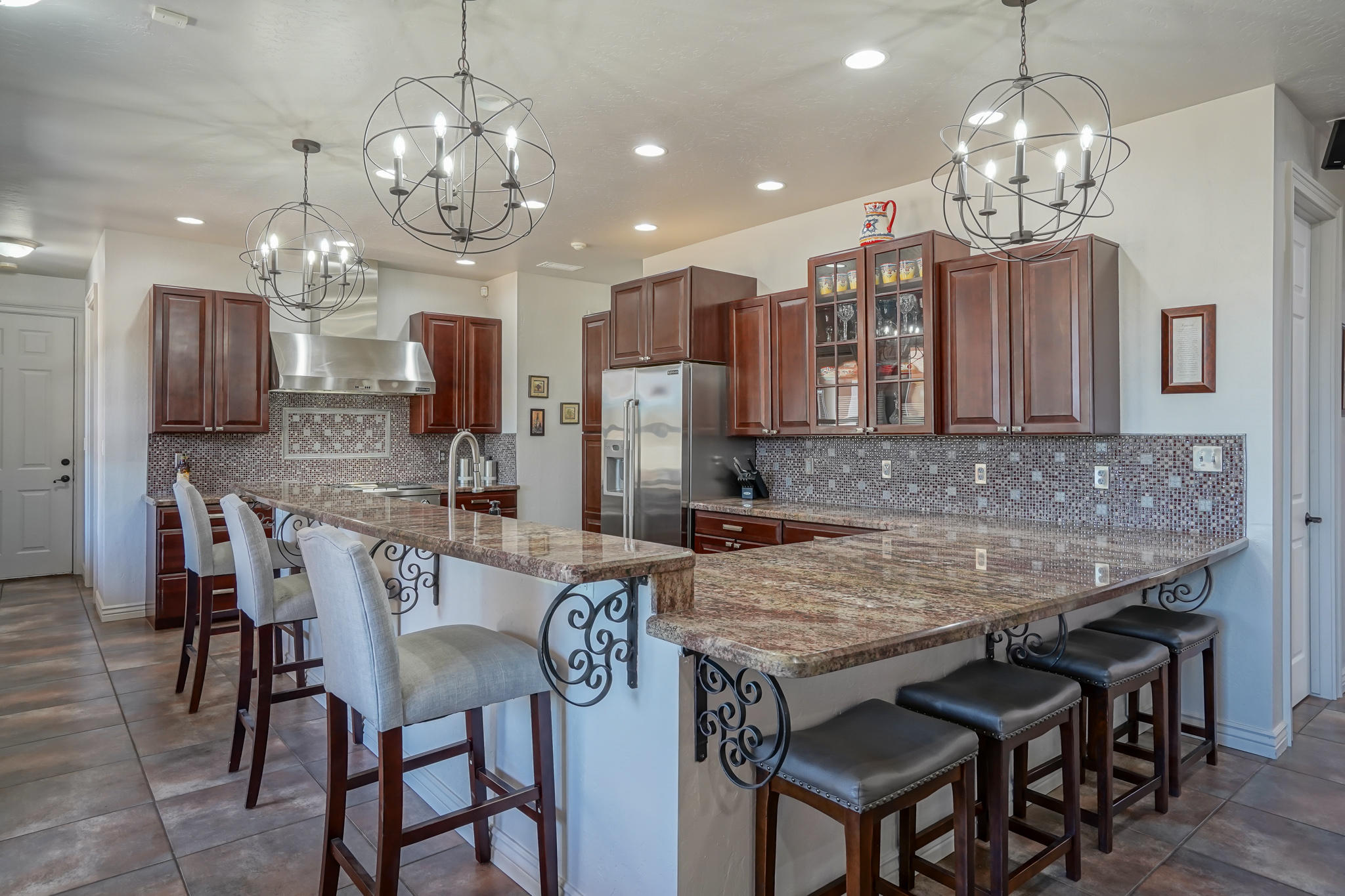 Stunning Custom Build in North ABQ Acres on .88 acres! The Main Home is a 4BD/ 3 BA with a 4 car garage.  Master Suite is conveniently located downstairs.  The Beautiful Kitchen boasts granite counters, a large breakfast bar, cherry cabinets, commercial grade, gas range and an oversized pantry. 2 living areas and 2 offices. The 4 car garage has its own heating and cooling. This area can be utilized as a gym or rec room.  Upstairs has 3 bedrooms and a full bath. This property has amazing mountain views.  The Backyard is perfect for entertaining, boasting 3 covered patios, 10 fruit trees, and a hot tub. Guest Home offers privacy and seclusion in 730 sq. ft.  1BR/1BA with a wood burning fireplace, refrigerated air and kitchenette. Schedule a private showing or take a virtual walkthrough!