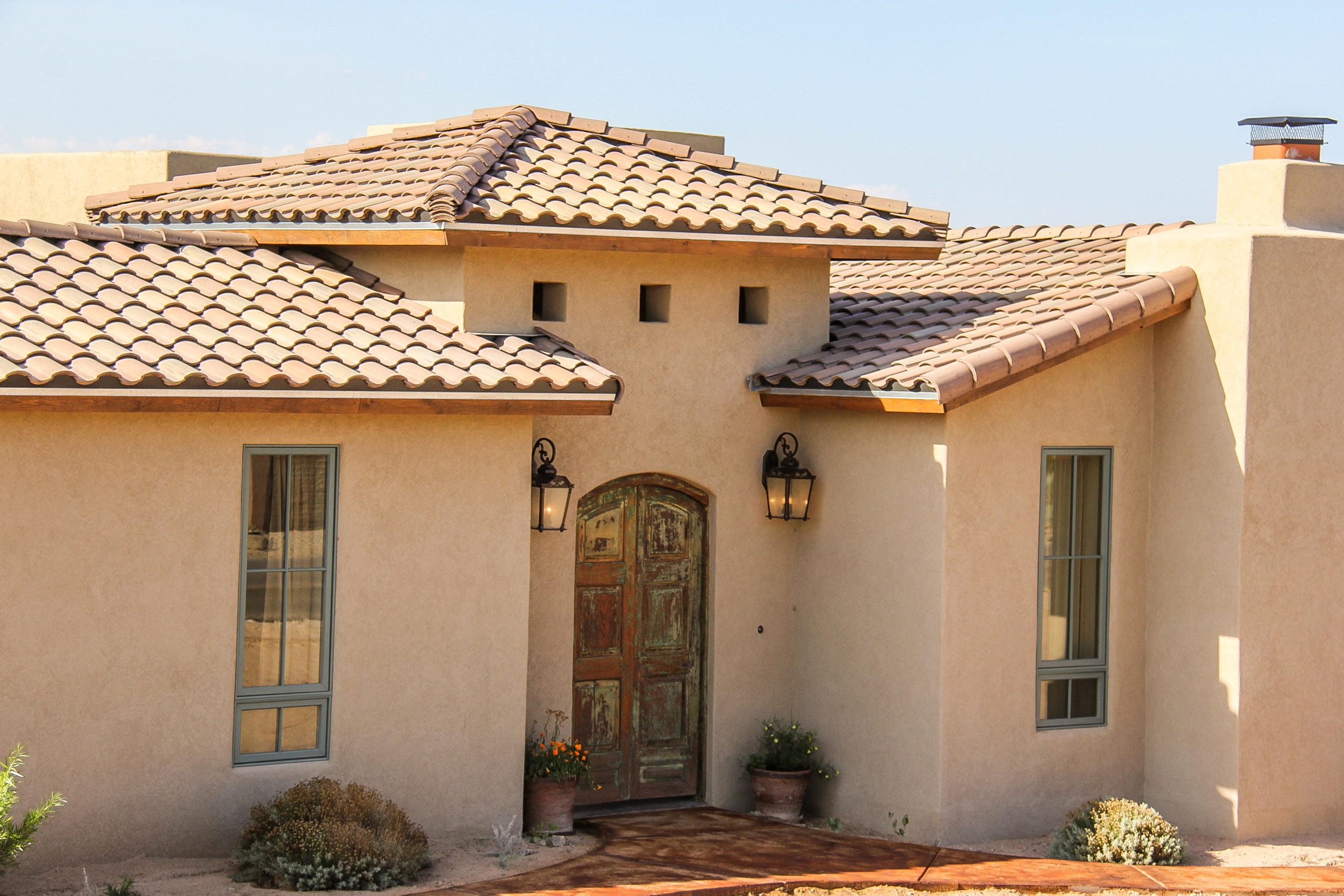 Stunning, Energy Efficient Green Home with amazing levels of luxurious amenities. Beautiful Custom Courtyard doors guide you into this traditional warm and inviting Tuscan styled home. This Home boasts Travertine tile, gleaming hardwood floors, Venetian plastered walls and cathedral ceilings through out, Custom Wood-burning fireplaces with stone mantle brick arches, along with picture views of the Sandia's. Kitchen area has built-in custom china hutch with granite top serving areas and beautiful cabinetry. This Gourmet Chef's Kitchen area is the heart of the home with inviting open entertaining space that features, Built-in Double-Sided refrigerator and freezer, professional series Stainless Steel 6 burner plus griddle, Large walk-in pantry  and so much more! Must see This Amazing Home!