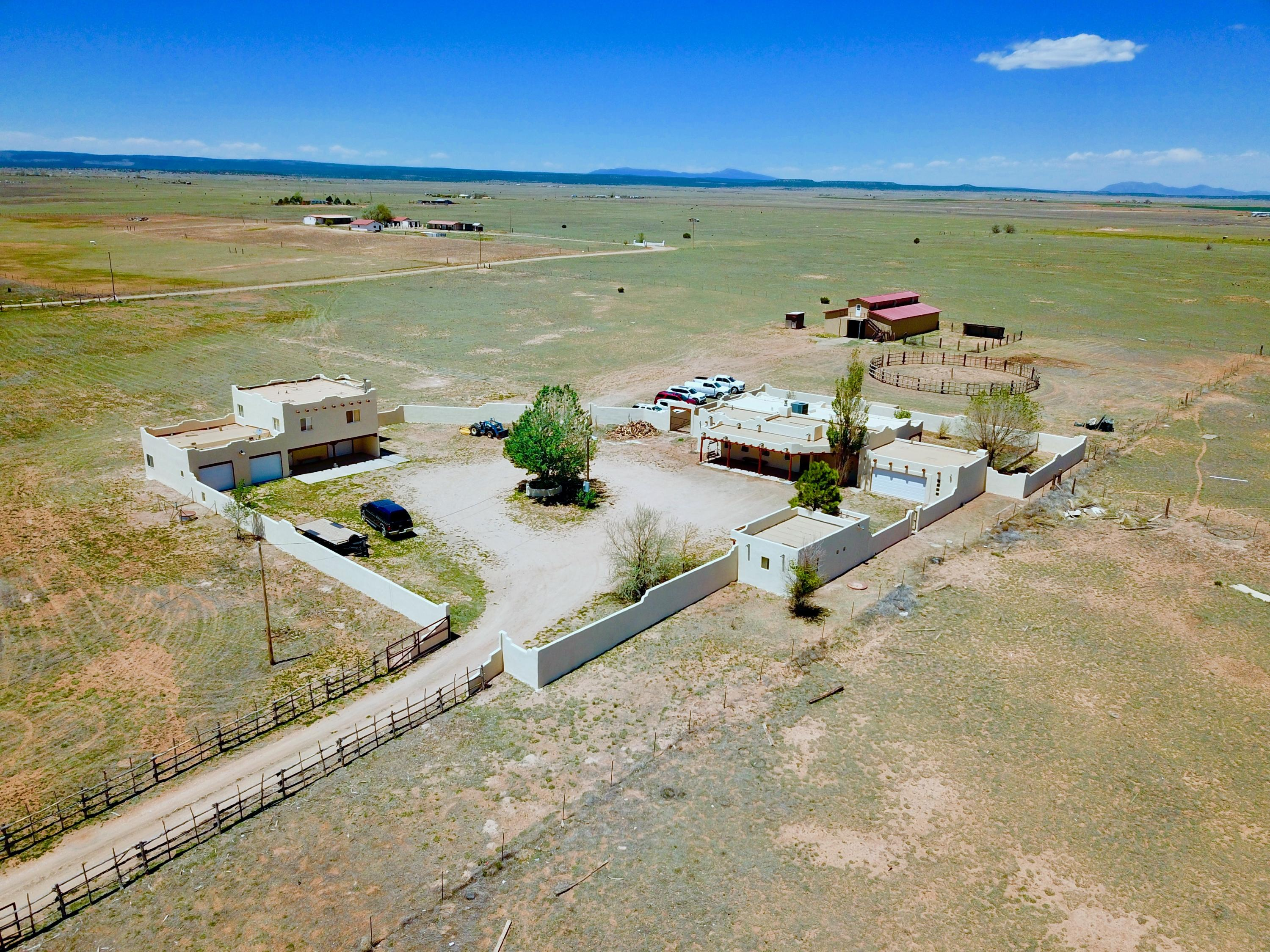 This New Mexico Pueble Style Estate is a horse property that sits on 10 acres of grassland and features 2277 sf of living space in the main house, 792 sf 2-bedroom guest house and 425 sf in a detached office and craft room for a total of 3494 sf of total living space. Horse facilities include a 40x60 barn with an upper level that measures 12x60 and a round pen. The property is fully fenced and cross fenced. The Cibola National Forest is less than 30 minutes away, Albuquerque is about 40 minutes and Santa Fe an hour.