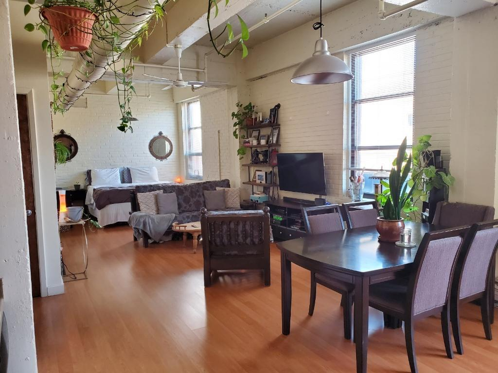 Bright and open urban style loft with large east side private patio. Exposed trusses, beams & brick. Hardwood maple cabinetry, birch interior solid core doors and S/S kitchen appliances. Secured building & parking with 1 covered parking space. Walking distance to restaurants, breweries and beautiful outdoor spaces. Rapid transit stop is also just steps away.