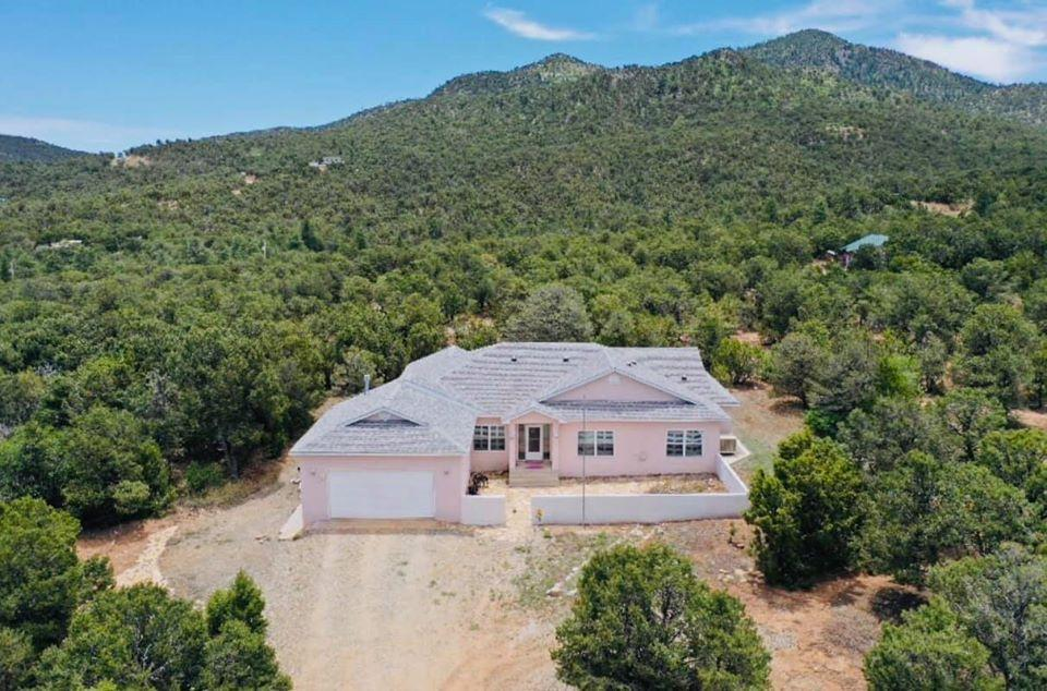 Welcome home to your Wilderness Oasis!! This home is tucked into the mountains with lots of trees and paths. Custom-built in 2001, this home boasts high ceilings and lots of natural light. Front office/study can also be a 4th bedroom.The timeless kitchen opens into the living room of huge windows that lead into the sunroom.The large 30x40 workshop comes complete with electrical! Own your own little slice of the mountains!! Virtual Tour available!