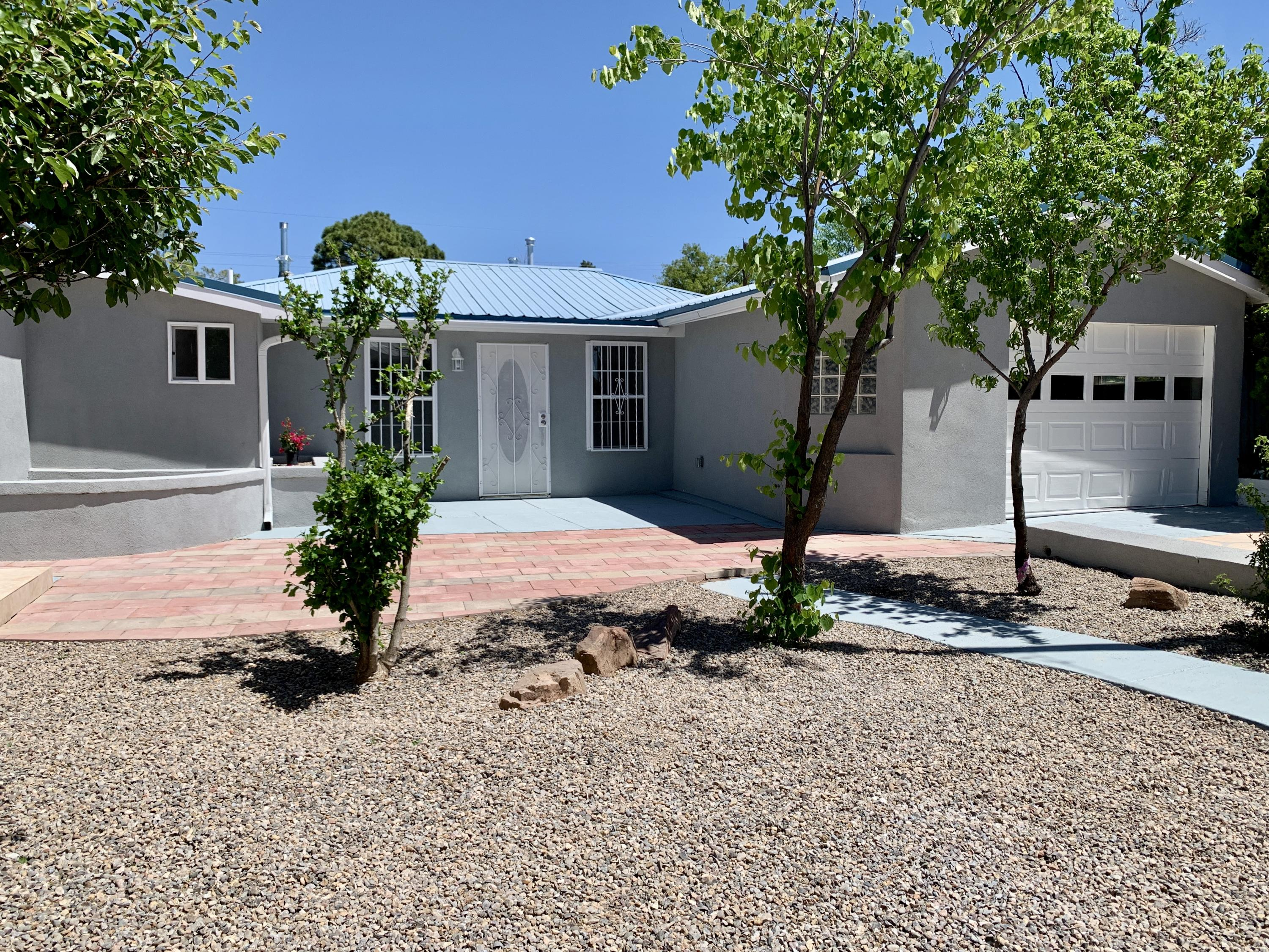 Nice family home with 5 bedrooms, 4 bathrooms, 2 living rooms 1 with fireplace, beautiful new kitchen with granite counter-tops & new appliances, pantry, spacious laundry room with washer & dryer,  finished garage, front, back & side yard, carport/workshop with plenty of parking, fenced with 2 separate gate entrances, this amazing home has been newly remodeled including new electrical, plumbing, water heater, A/C & Heating, gas lines, carpet, tile, paint, windows, doors, stucco , gutters, vanities & fixtures . centrally located near i40 & 12th st. come take a look !
