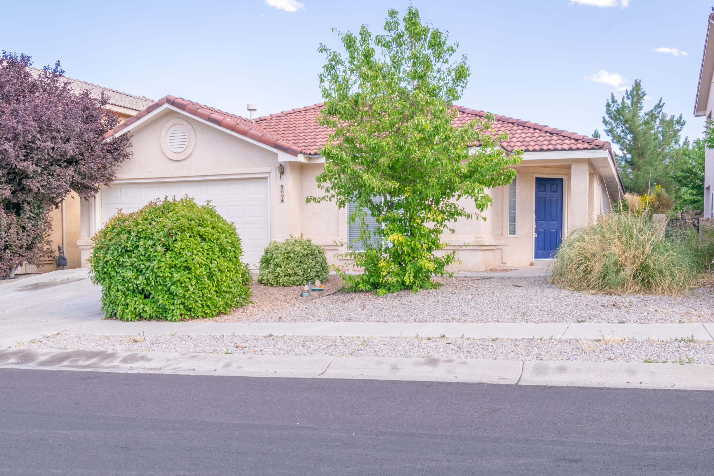 Beautiful 4 Bedroom, 2 bath home, newly painted, new carpet, 2 living areas,  tile roof, all ready for you to add your personal touch.  Cozy up against the two way fireplace in this open floor plan.  Easy to show!