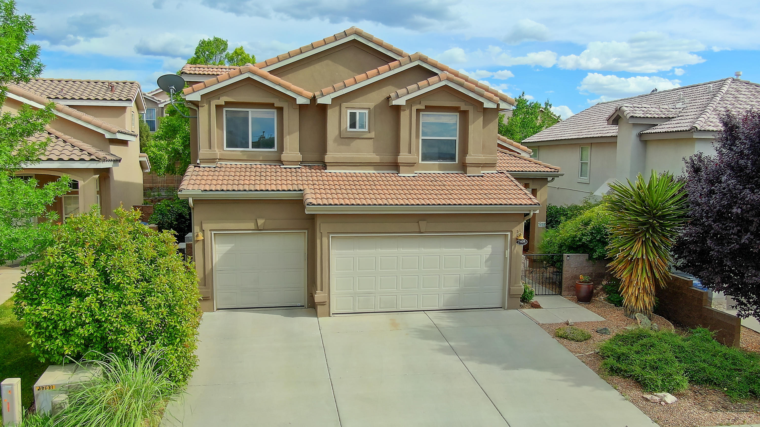 Beautiful home located in the Desert Ridge Trails community.  Home Features - An updated gourmet kitchen with island and granite counters tops that opens up to the large great room with fireplace, 2 living areas, very large master suite with separate retreat area, covered balcony off the master, downstairs bedroom and full bath room,  Inviting and private backyard with large trees and pond and large 3 car garage for all the toys!