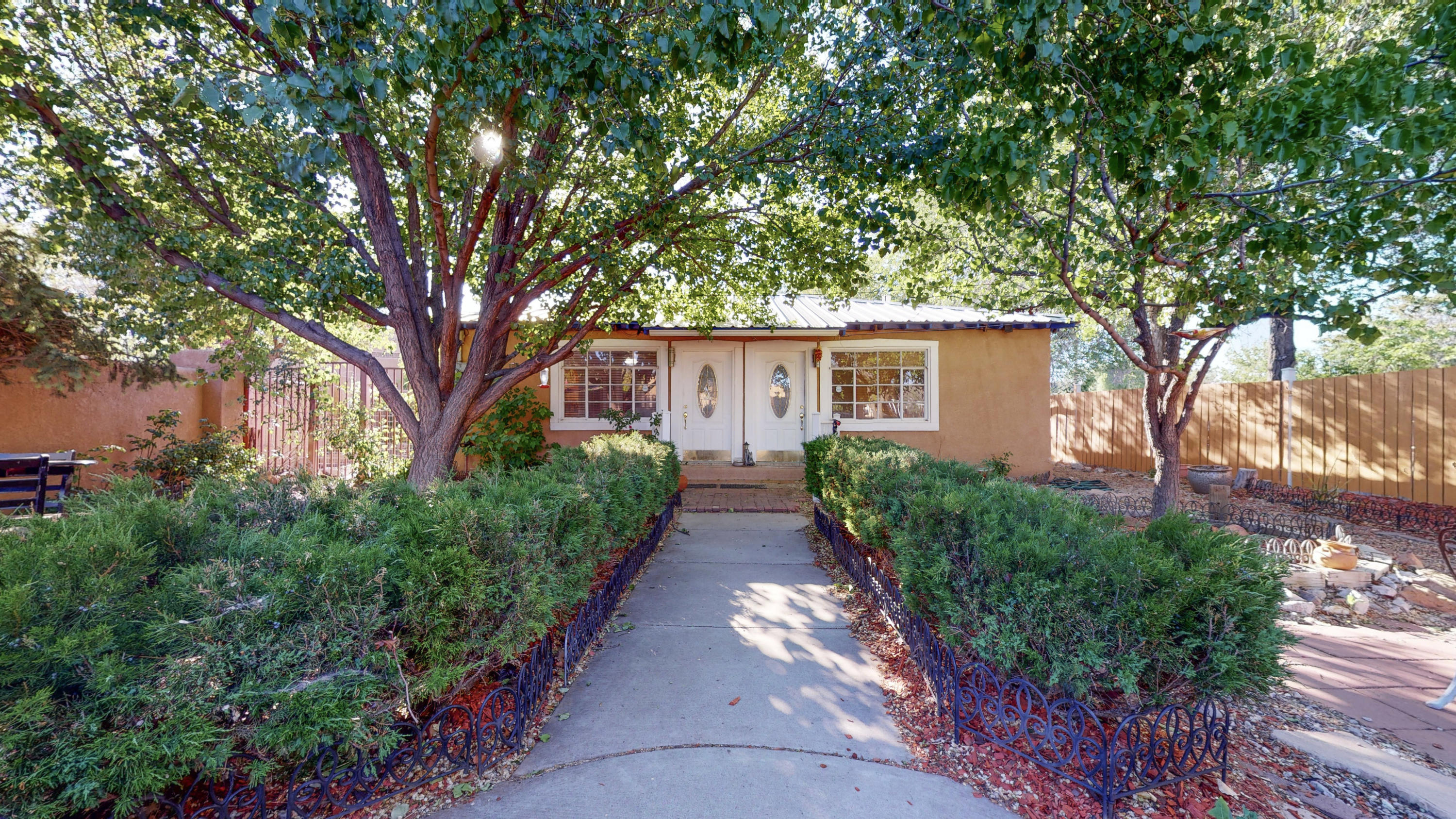 Beautiful North Valley property!  Just off Rio Grande near Old town and the Nature Center with easy access to the bosque trails and just north of I-40.  Gated and fully fenced with  mature  landscape off a private, fairly hidden driveway.   This townhome would be a great opportunity for rental income, an office for an attorney or CPA or a great space for a marijuana dispensary.   Up to 6 private parking spaces with community parking available. Rare Zoning!Zoned C-1 & Multi-family Res U4U, Current rental income is $1295 per unit.