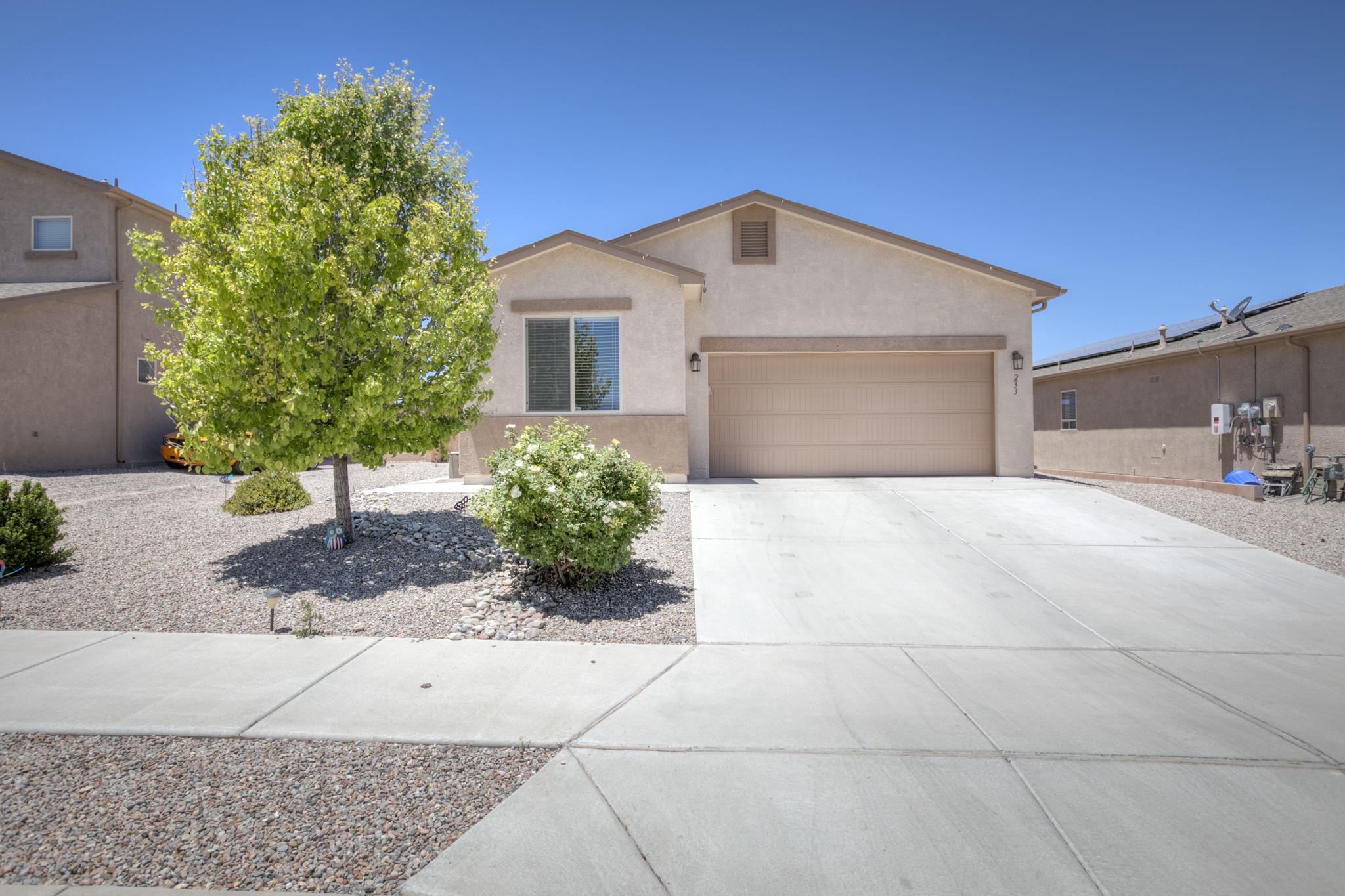 An open floorplan, a large expanded covered patio and plenty of upgrades await the new owner of this newer, green built house in Rio Rancho.  The wide-open great room includes upgraded 18-inch ceramic tile that spans into the dining room and kitchen.  The kitchen has plenty of spacious cabinets that span across to a large kitchen island for added counter and cabinet space.  Kitchen includes all stainless-steel appliances along with refrigerator.  In addition to three bedrooms, the home includes an additional room that could be used as a home office or playroom.  Additionally solar panel system to help keep utility costs to a minimum.  Come make this move in ready house your home.