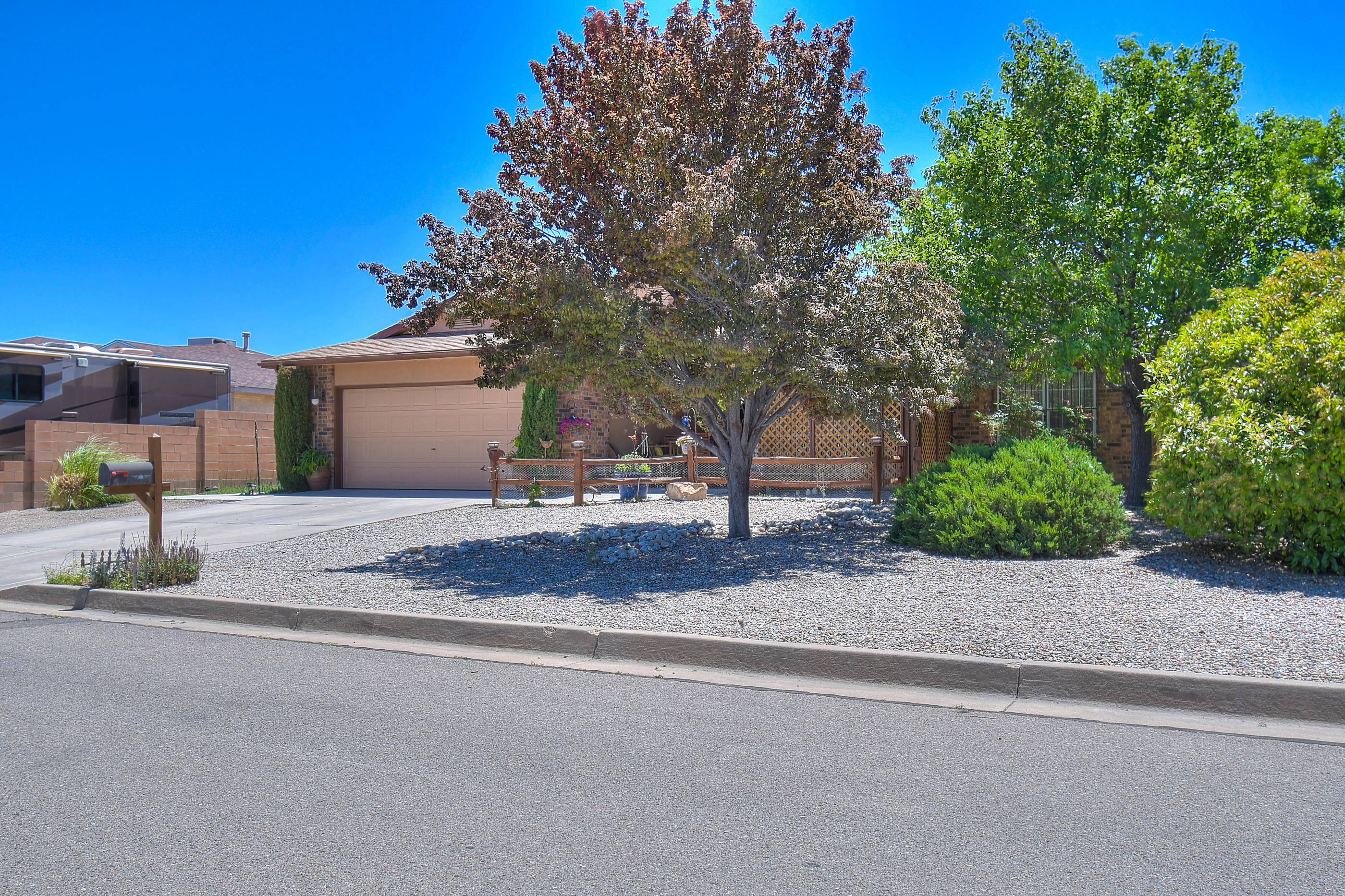 Dont miss out on this amazing home in Park West in Rio Rancho. This home features 1659 sq. ft 3 bedroom, 2 baths, a full 2 car garage PLUS a detached single car garage in the back! This remodeled home features updated windows, refrigerated air, and updated lighting. Kitchen features oak cabinets with plenty of storage and built-in pantry and tile backsplash. Kitchen opens to breakfast nook with bay window and full dining with sliding glass door to the well manicured backyard. Great room is finished with laminate wood floor and fireplace. The Master Suite features 2 big closets and a updated Master Bathroom with separate soaking tub and shower! Custom Vanity with split mirrors and low level lighting. Close to shopping, dining and the movie theater. Great Location in central Rio Rancho.
