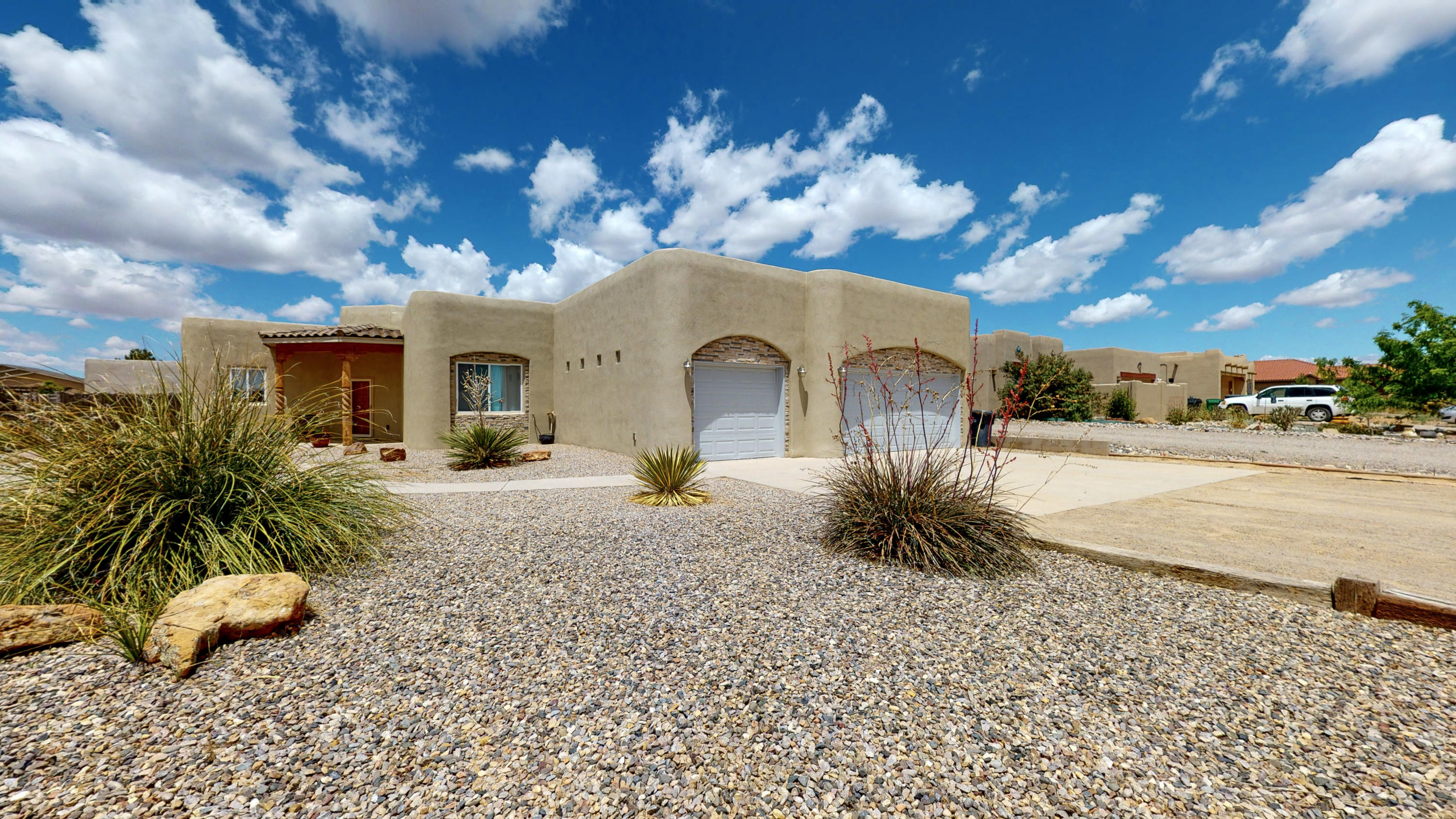 This beautiful  Pueblo Style 1/2 acre property is available for its new owners! With 4 bedrooms, 2.5 bathrooms and 3 car garage, your family will have all the space you need!  Make an appointment to view today!