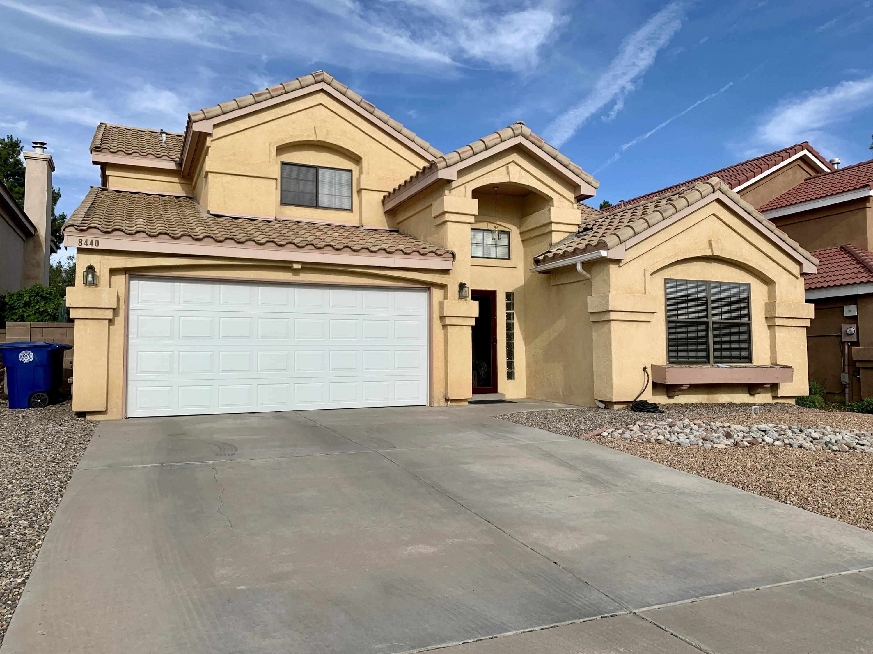 This NE heights home quite literally has it all!Located just walking distance from La Cueva HS, it is in one of the highest rated school districts in NM. Separate formal Living/Dining rooms in front, Kitchen, Breakfast Nook, Family room in the back of the home.  With 4 bedrooms, Including one on the main floor, 3 full bathrooms, Master is upstairs with a fantastic view deck.  The east facing backyard is a private retreat, sunny in the morning, shady and cool in the evening.
