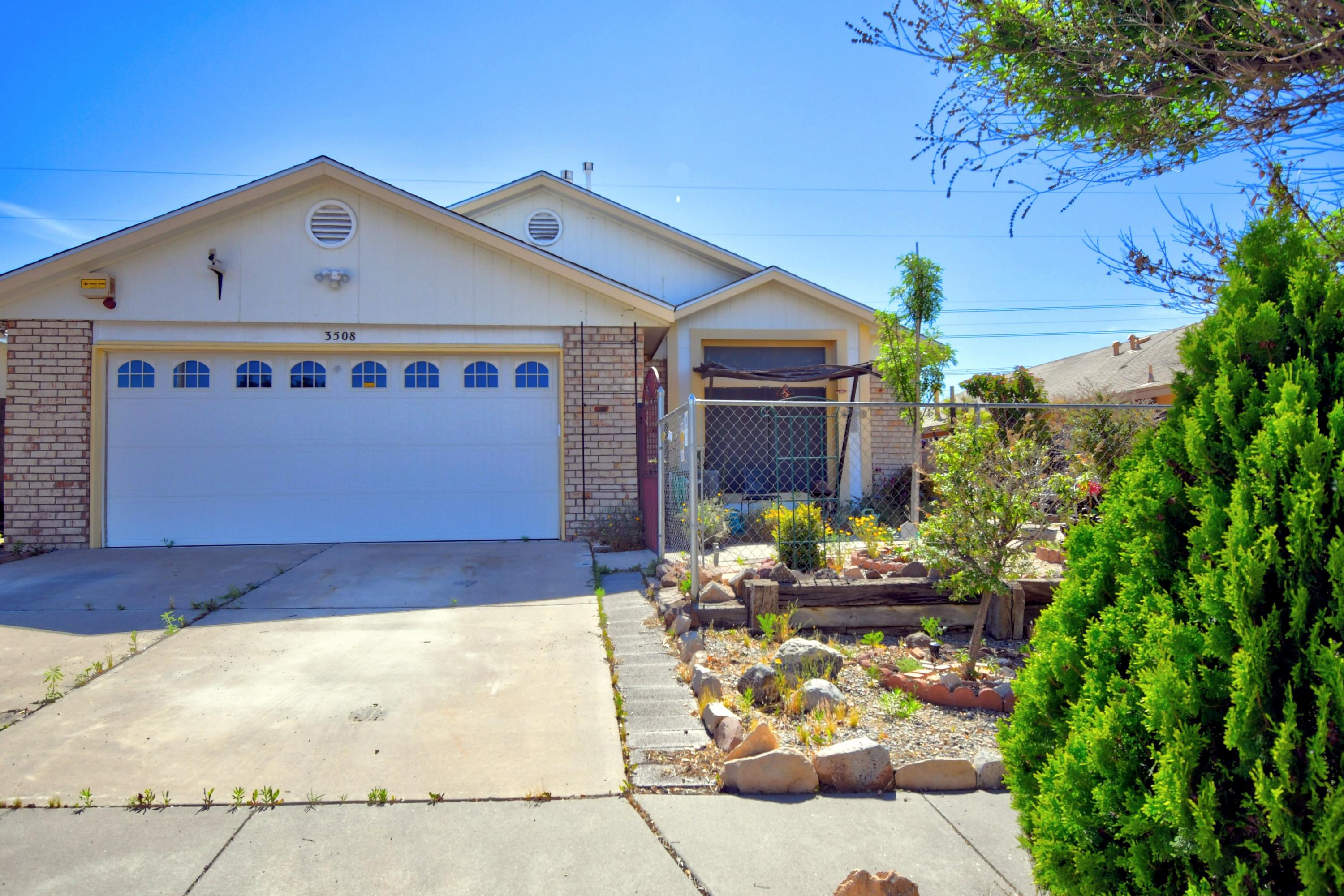 Bright open floor plan with vaulted living area ceilings and a cute cherry kitchen! This 3 bedroom home is conveniently located near shopping, highways and restaurants. Newer Refrigerated Air! Large Lot with exceptional views of the Sandias.