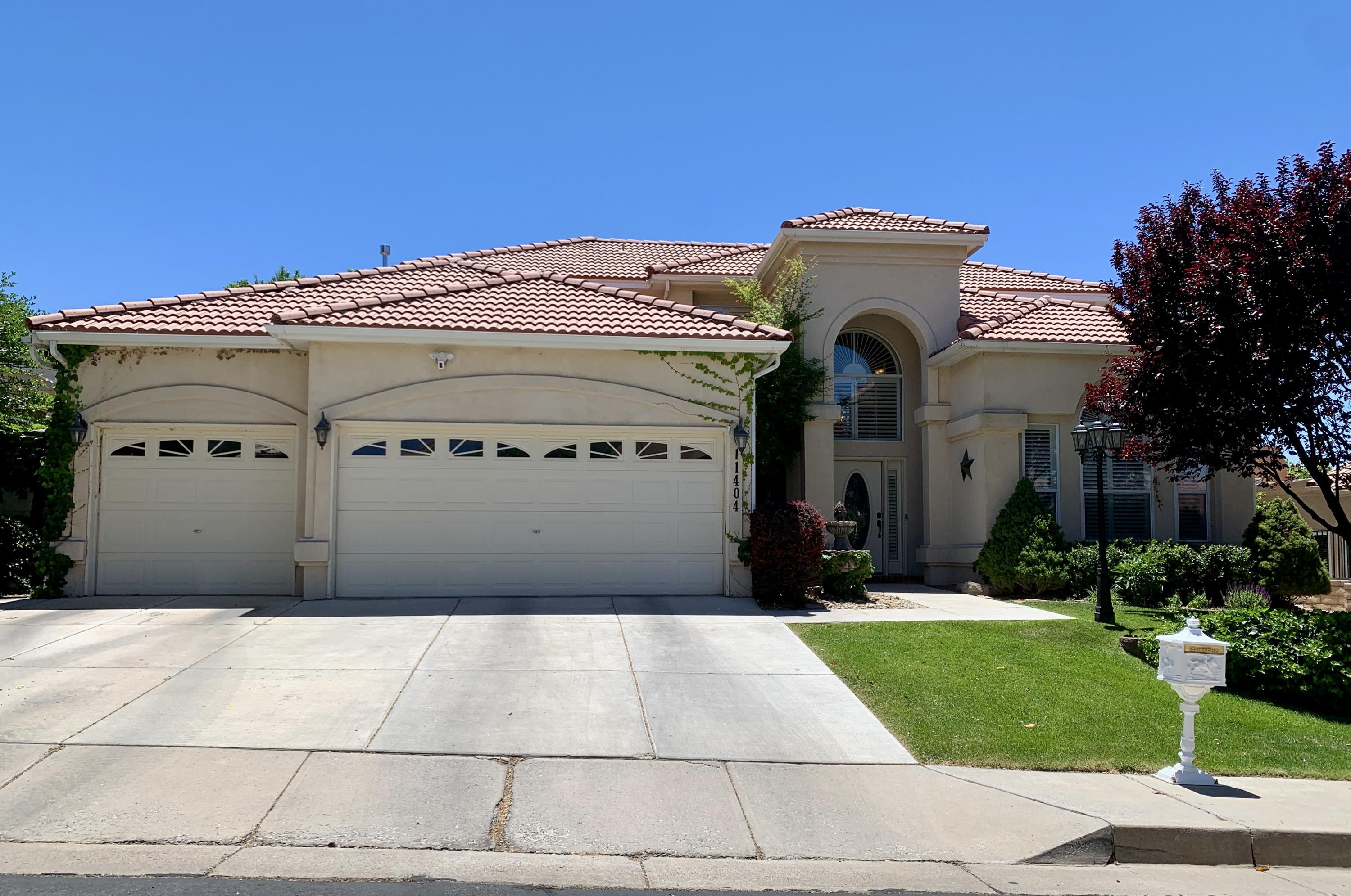 Beautiful home in gated Tanoan Country Club / Tanoan East. Master bedroom downstairs, 3 bedrooms upstairs.  Lots of updates, 3 car garage.  Private back yard. 2 living areas, big formal dining. Won't last long!