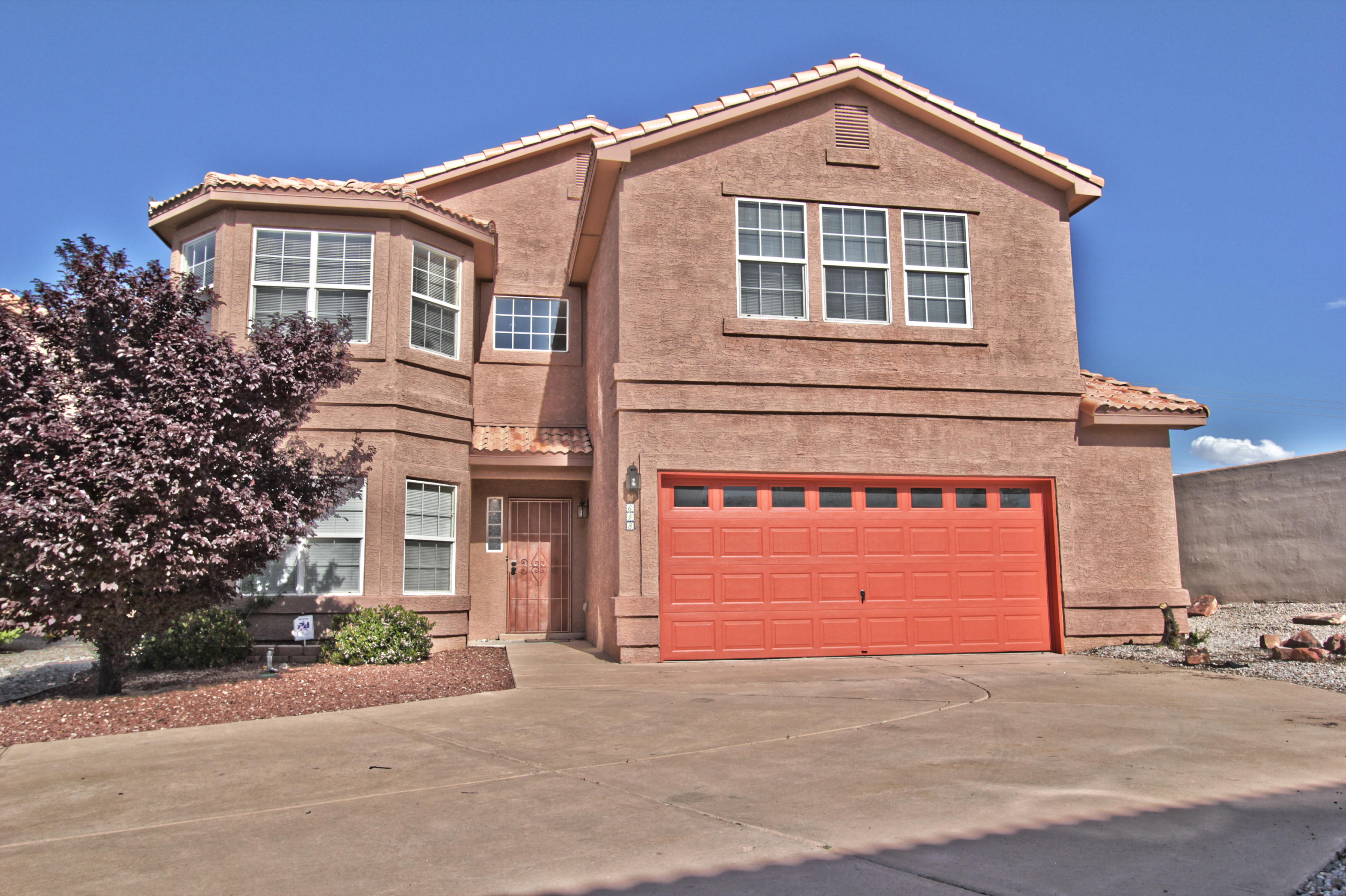 Welcome to the GATED community of Encanto Village community where homeowner's take pride in ownership.  Extra space on side yard with BACKYARD ACCESS. Large low maintenance front and  back yards. 5 bedrooms, 2 large living areas, and 2 dining areas.  Kitchen opens to dining and one living area with lots of storage, a large pantry, and island for extra cooking space.  PORCELAIN wood-like tile throughout with gorgeous wood stairs and landing, and newer carpet in bedrooms.   Enter the backyard through the sliding glass door and relax on the large covered patio with a gas stub-out.  Tiled roof, and amazing mountain views from the upstairs deck. Make your way through the french doors to the roomy master bedroom with a huge walk-in closet. The master bath and main bath offer private latrines