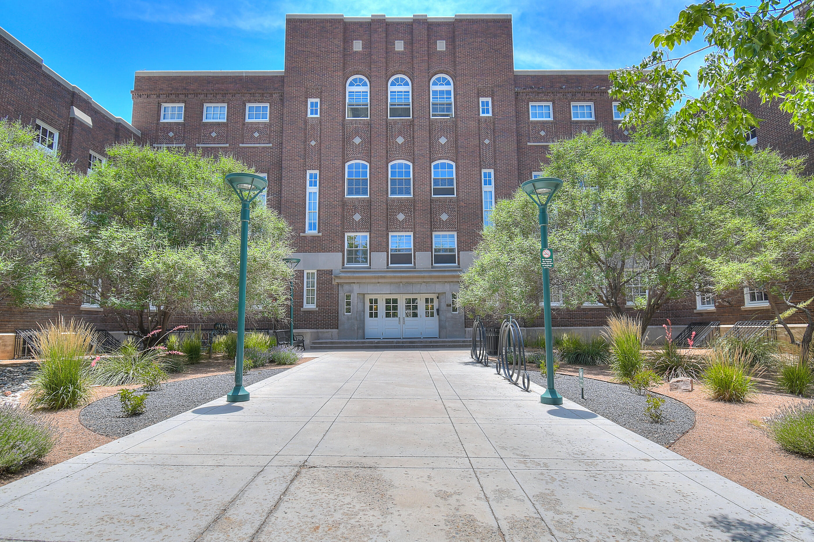 Live the downtown urban lifestyle you crave!  Located in the Historic Albuquerque High Gym Lofts, this stylish condo has a bright greatroom with engineered wood on entry level, large kitchen island and an upgraded bath with gigantic glass enclosed shower.  A winding staircase brings you to the loft/master area with full bath.  HOA fees cover water, trash, recycling and ground maintenance.