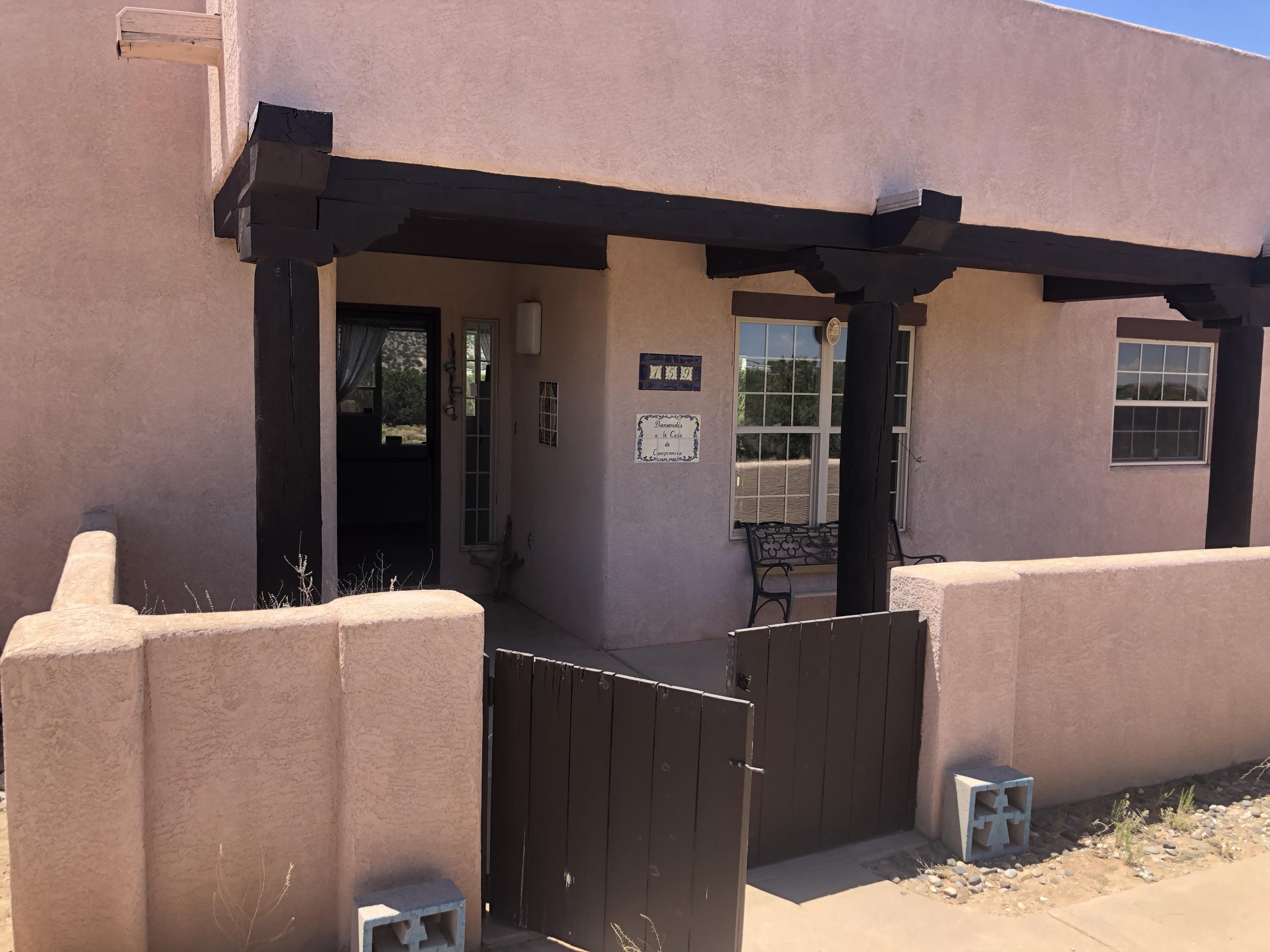 Great home amazing views with an open floor plan large windows helps to bring the amazing view indoors.  Southwestern details in this home are are right in line with the surroundings of the property.  Open floor plan, Saltio tile, wood beams in the ceiling, wood burning fireplace.  This home is move in ready come take a look today.