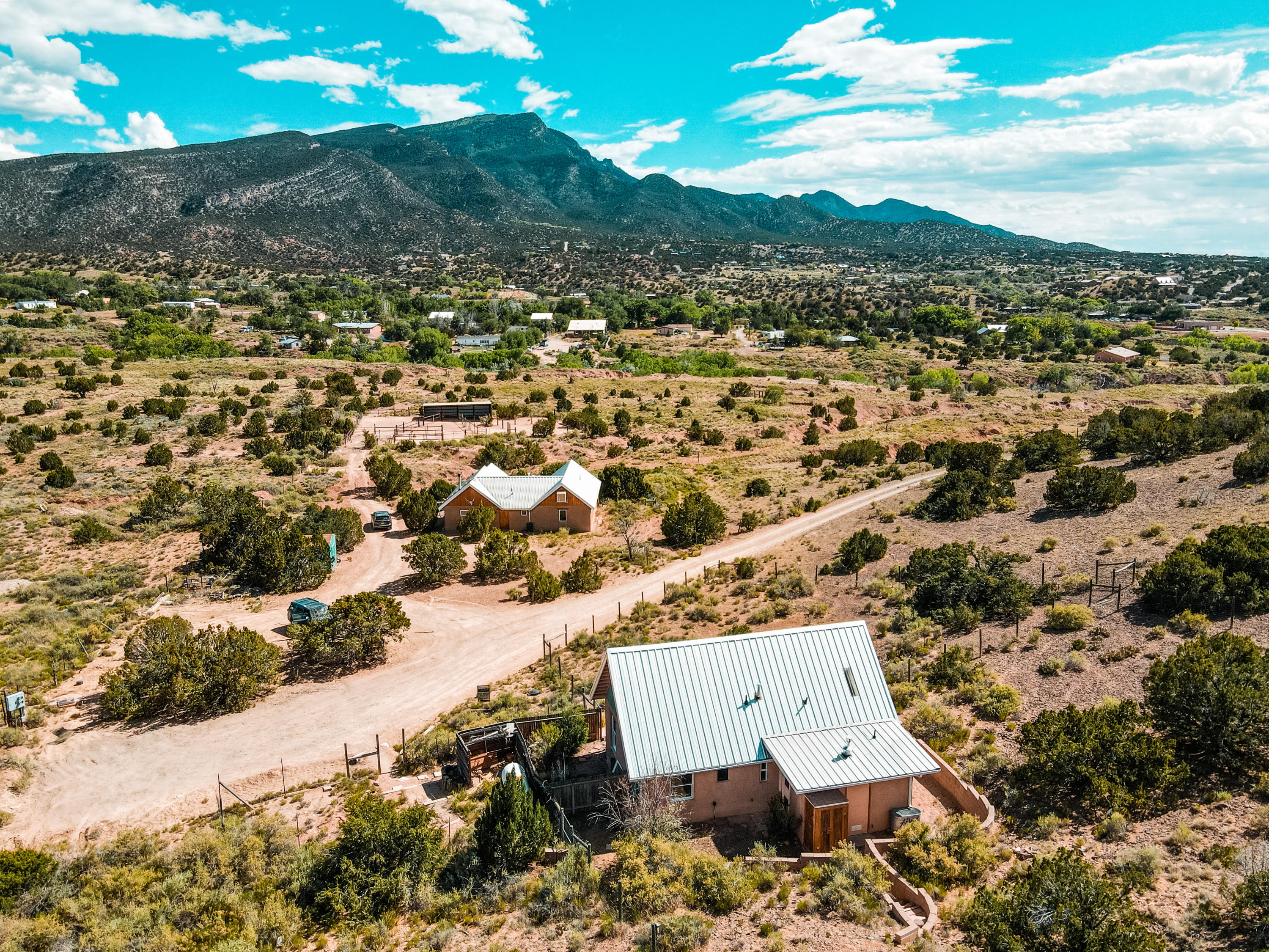 Fall in love with this adorable adobe home on 3.67 acres. 2 Bed (1 bed plus upstairs loft), open kitchen and living room with cathedral ceiling. Master bedroom with wood beam ceilings downstairs with 3/4 bath and utility/mud room. Stained concrete & wood flooring, adobe walls, radiant plus baseboard heat. Great vacation rental, artist studio or getaway home. Horses allowed. Gorgeous views of the Sandia Mountains and rolling landscape of Placitas New Mexico, what a find!