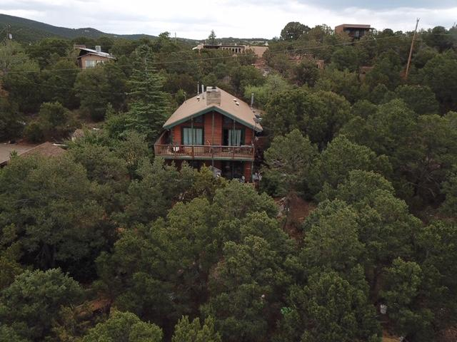 Wonderful views from the upper and lower decks on this custom log home.Cathedral Ceilings with T & G.  Living and dinning room and fireplace.  Master bdrm upstairs and 3 bdrms on lower level. Community water and LP Gas and Electric Heat.  Buyer to rely on on inspections.