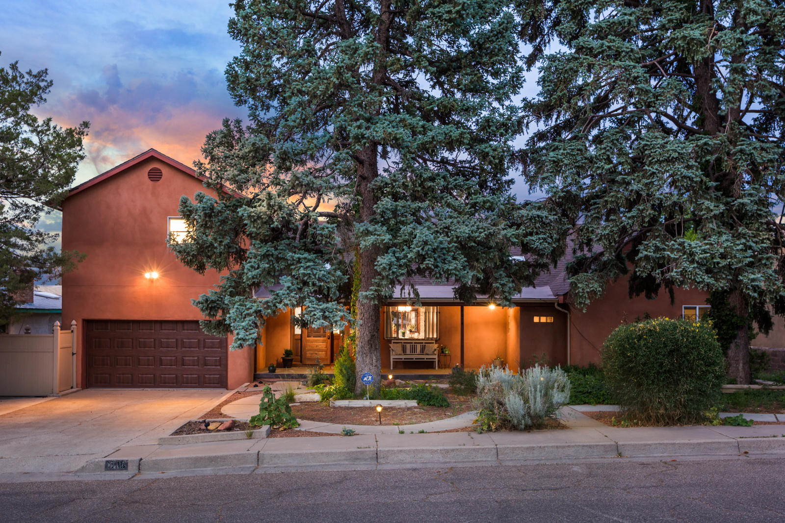 Welcome to this lovely Ridgecrest home! Northern NM inspired architecture. Multi generational flexible Floorplan! 4 bedrooms, 4 baths - two possible Masters with ensuite. Main Master is up with wonderful mountains views and outside deck. Garden level suite includes living area with fireplace, bedroom, sauna, Jacuzzi hot tub and 3/4 bath. Well designed kitchen with stainless appliances, granite counters and beautiful cabinetry. Two generous living areas, formal living on main level, basement makes perfect hangout space/man cave/bar/you name it! Screen porch for summer dining. Very large backyard complete with newer solid perimeter wall, great for kids and pets. Lovely patio with fire pit, fruit trees and grape vines. The most versatile home in Ridgecrest!