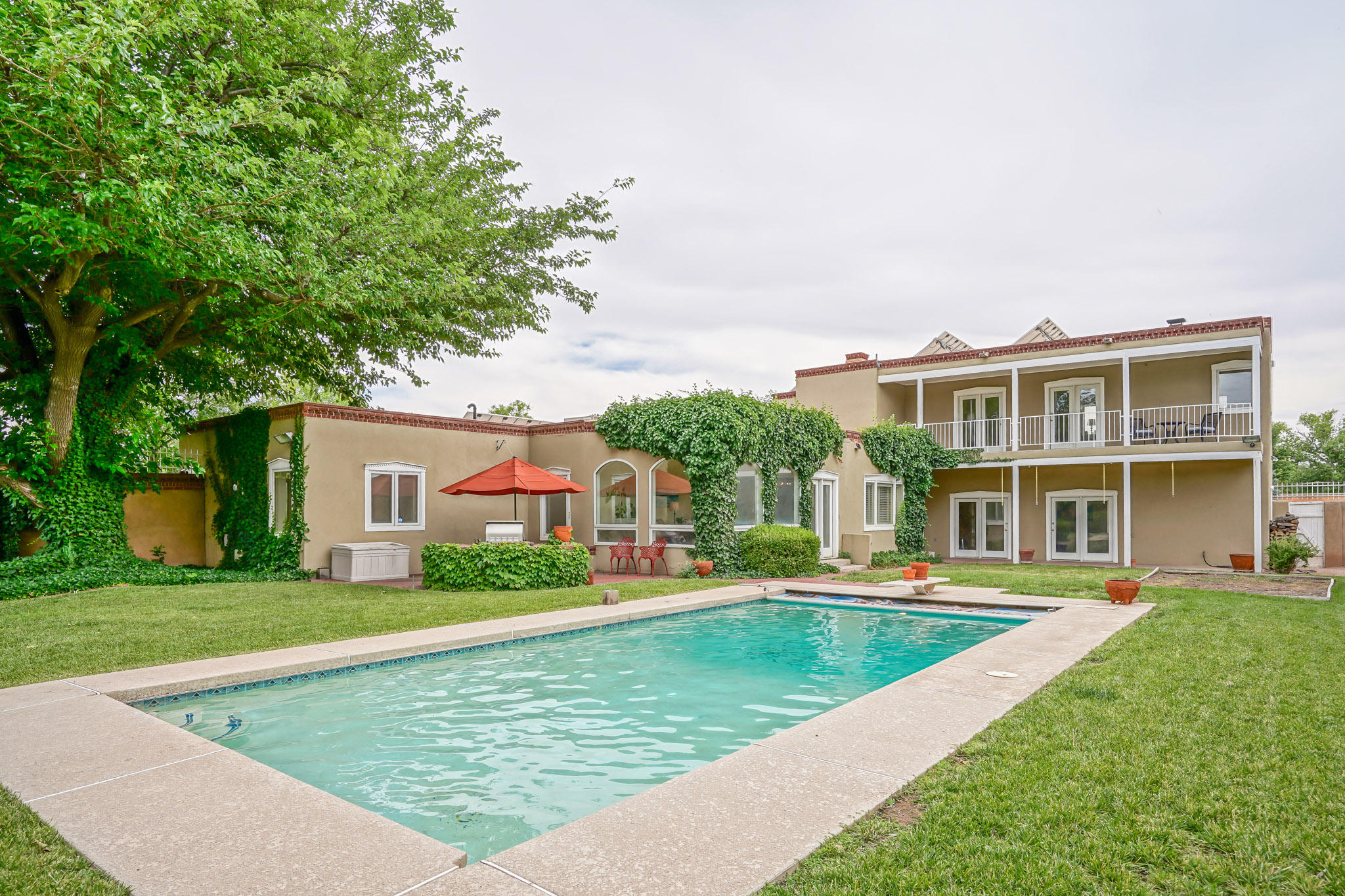 Rare find! Beautiful, rambling, Classic Spanish Territorial on .42 of Acre across from lush green Prado Del Sol park. 5 Bedroom, 6 bath, Double Masters - one up; one down. Sparkling Gunite Swimming pool amidst a private backyard oasis. Features coveted brick floors, stunning refinished red hardwood oak floors, Lifetime transferable warranty TPO roof, top of the line Sub-Zero fridge/freezer, double ovens, 5 burner cooktop, Fire Magic Grill, Whole House backup generator system, owned Solar with no electric bill, epoxy garage floors. Ready for your vision -- solid enduring construction. So convenient to Uptown Shopping, Trader Joe's, Sunport Airport, Downtown, Air Force Base and UNM. Checkout the Virtual Tour in photo tab.