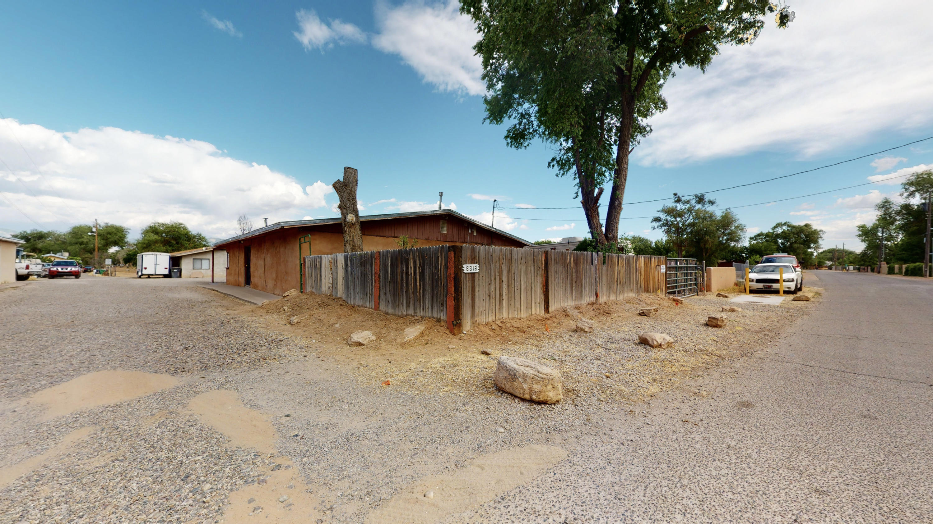 Property in the Heart of Los Ranchos!!! This adobe home has lots of potential and is need of the perfect buyer to give it some TLC. Sits on 2.73 acres of land that has irrigation rights.  Large workshop has plumbing and electricity available. Property can be subdivided. Schedule showings via ShowingTime