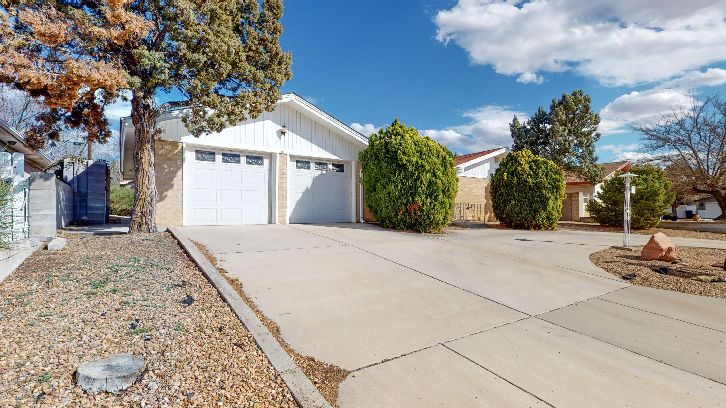 Come and see this adorable 3 bedroom 2 bathroom home conveniently located close to Albuquerque's popular uptown. This home boasts 2 bedrooms with connected bathrooms. The third bedroom can be used as an office or bedroom and has a wood burning fireplace. This recently updated home has brand new carpet installed February 2020, Fresh Paint throughout the entire home and is priced to sell fast!!!! This private/hidden community located in Vista Encantada Subdivision is perfect if you like privacy but also love convenience.