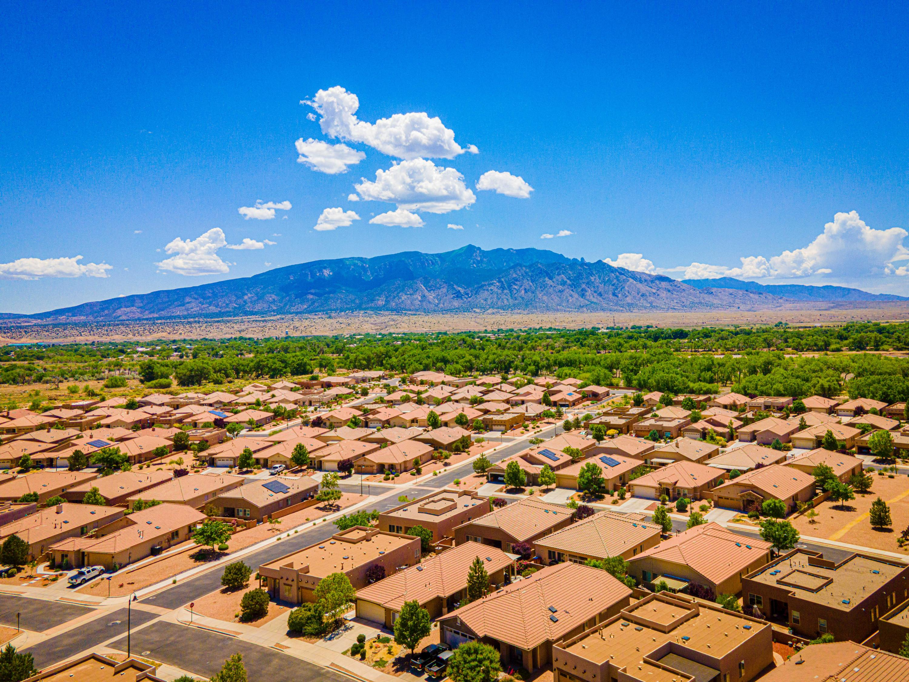 Welcome to Del Webb Alegria, a 55+ gated community!  This Popular 'TAOS' model floorplan sits on a corner lot which has gorgeous professional landscaping and is across from the walking trail!  Home is 2156 SF and has 2 large Bedrooms plus an Office/Den, Dining Room, REF AIR, Gas Log FP, Large Kitchen w/beautiful cabinetry and lots of storage, Corian Counter-tops, Double Oven, Gas cook-top, Pantry, Island and nook! All appliances stay incl. washer and dryer.  Hot Tub in backyard conveys.  Many of the furnishings in the home are available. Home has had a home inspection and all repairs (very minor) are being addressed and corrected. You will enjoy the Clubhouse which has daily activities, indoor and outdoor pool, gym, etc!  Access to the Rio Grande Bosque too!  Home is move in ready!!