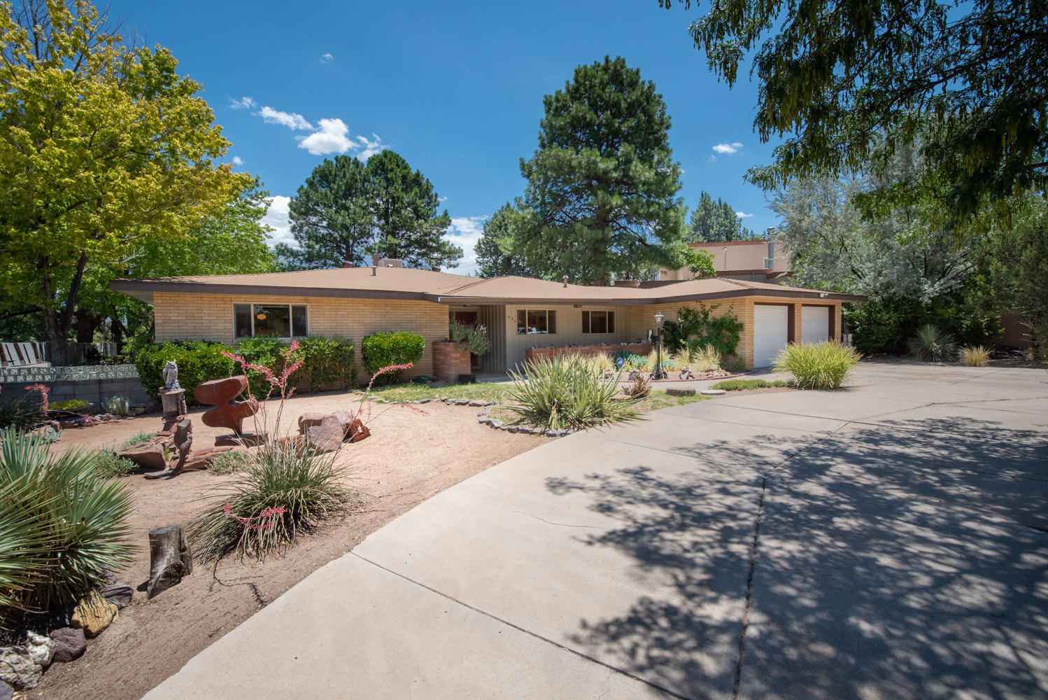 This architectural 1 story rambling ranch home rests in Ridgecrest on a quiet street with a circular driveway in a genuine tree shaded neighborhood. Over sized backyard with deck has a lot of fun sitting areas for a must have for entertaining with a private wall for privacy. New roof in 2018 & sewer line.This home has great bones with  endless hardwood floos. Comfortable  sized bedrooms. MBedroom suite 22x20 & dressing room 8x10.  Eat-in Kitchen 19x18  & formal dining room.  Marble window sills under the newer thermal windows throughout.  Lot of mid century modern accents like the kitchen cabinets and wood in the den area next to the wood burning fireplace. The hallway would be a perfect gallery for artistic art work to display. Central forced air, refrigerated air & evaporative cooling.