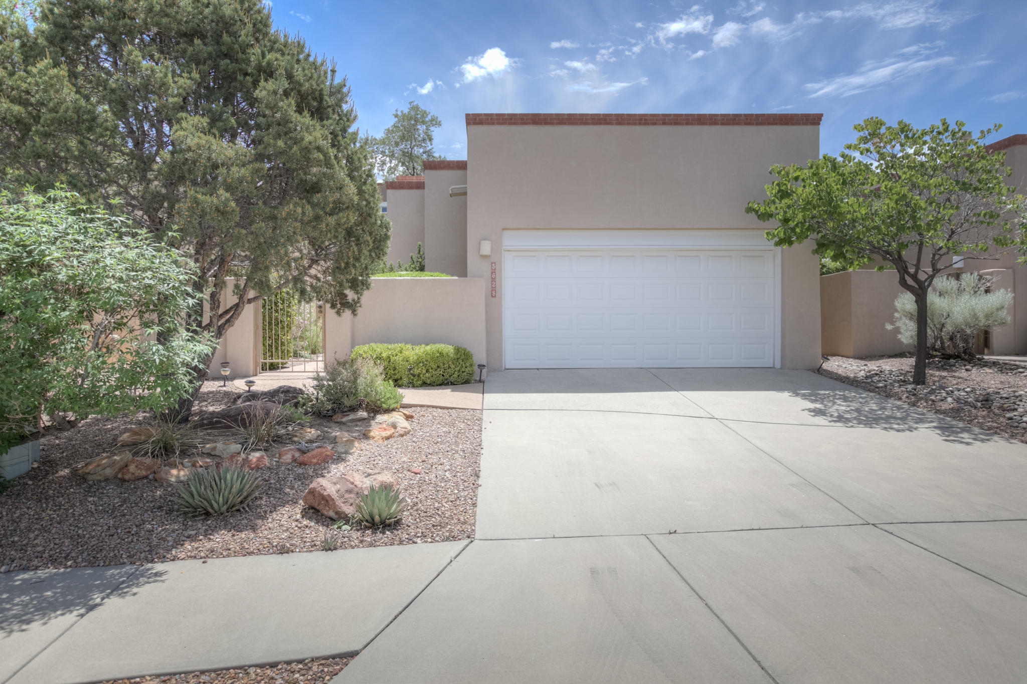enjoy easy living!! Nestled in prestigous High Desert, Elegant territorial style patio home w/ private gated courtyard entrance. Stunning  Great room concept  w soaring ceiling, recessed lighting lots of great natural light, and a  gas fireplace.  Open living concept, gourmet kitchen w / island, pantry, beautiful tile backsplash,  , gas cook top and Eat in dining space w/ french doors to the out doors.  Gorgeous master suite w/ adjoining bathroom, double vanities, walk in shower, and walk in closet.  Radiant heat, evap . cooling, skylights,  , New TPO roof in 2019, brand new hot water heater 1/08/2020.  Low maintenance easy care yard w/ patio and lots of privacy.
