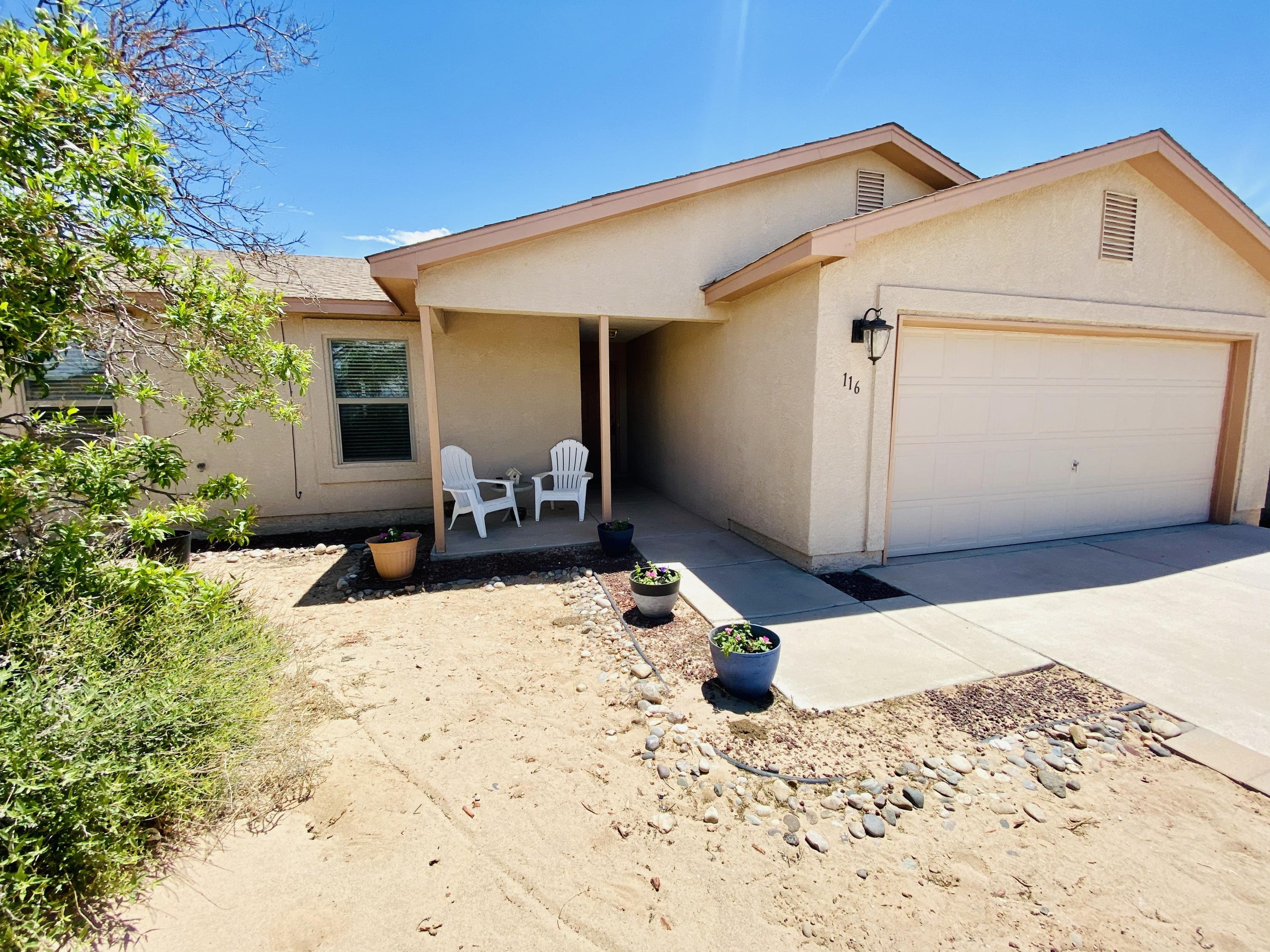 Views, Views, Views! Cute 3 bedroom home located on a quite street, situated on a half acre lot, with backyard access!  Interior features ceramic tile and laminate wood floors.  This home is clean and move in ready! Do not miss your chance at this West Rio Rancho Gem!