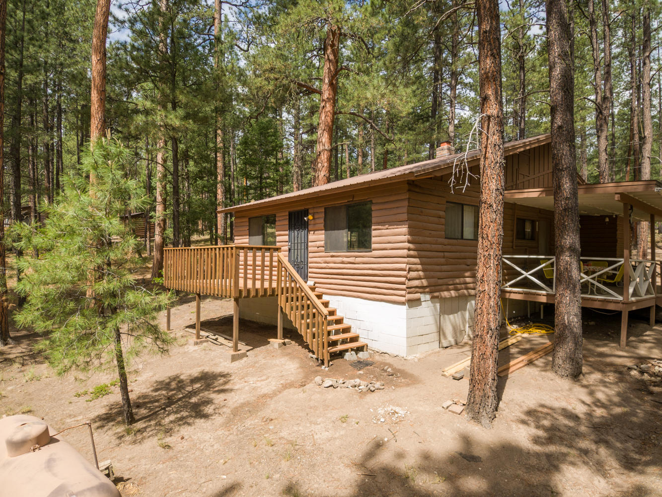 Heaven in Jemez Springs! Charming cabin in Horseshoe Springs. Surrounded by Soaring Ponderosas and fresh mountain air, and a meadow near by. Enjoy the outdoors on a cover porch or an open deck. Home is on a community water system and a well managed HOA. Covenants do not allow short term rentals or AirBnB.  Good sized storage shed on property and .70 acre lot. Easy commute from Albuquerque, Santa Fe and Los Alamos.