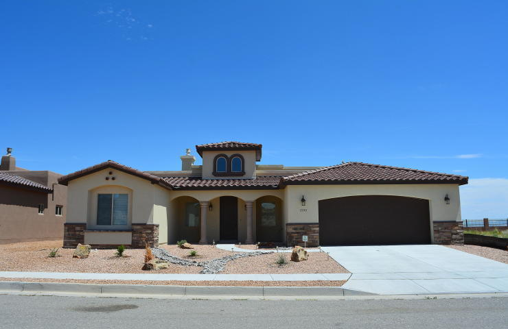 Welcome to Rio Rancho Estates and this Tuscan style home. Unobstructed views of the Sandia Mtn. from the living room and covered back porch. Open floor plan with plenty space. 12 ft ceiling in the living area. Master suite has amazing views as well. Jetted tub and snail shape shower are standard. Each bedroom occupies it's own corner of the home. The list of amenities goes on and on. No HOA or PID! Call for info and details. Quality Builders '' a Higher Degree of Excellence''.