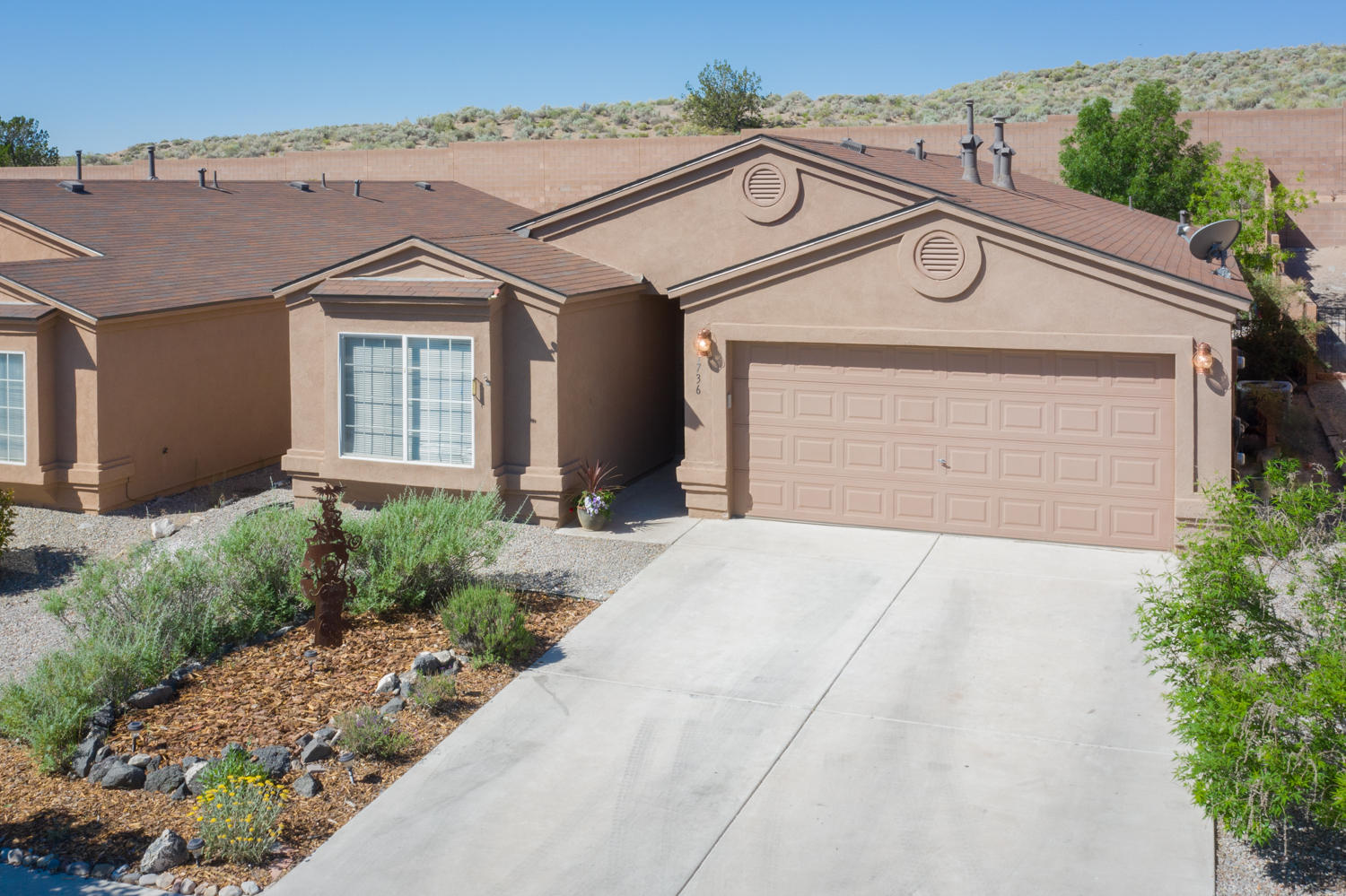 You are sure to love this 4 bedroom single story home nestled in the Sierra Norte subdivision in Rio Rancho.  This popular single story plan has 1694 sqft in all the right places! Immediately when you step in you'll notice the upgraded carpet welcomes you home.  In the kitchen you will  find granite,  newer stainless appliances, and a very functional layout. The spacious master is secluded to the rear of the home off of the very open living room. The surprise continue as you head outback to the recently update and upgraded backyard. This little oasis has the perfect covered flagstone patio, and custom sunshades so you can enjoy your evenings with out too much sun. When you combine all this with a very affordable budget, you will want to see this hidden gem sooner than later.