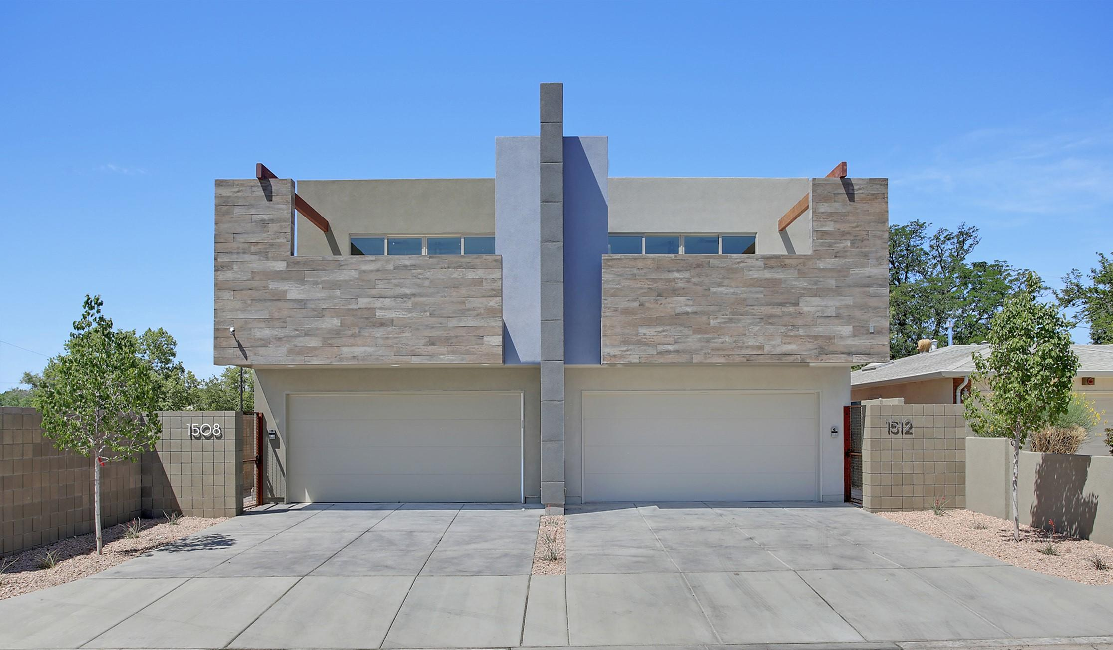 Designed by Architect William Osofsky,  located in the desirable ABQ Country Club, is a Multigenerational State of the Art Solar Townhome. The Future of Housing is Here! Two Dwellings under One Roof. The Garden level unit is 1300 SF with 2 Bedrooms & 2 Bathrooms, a Premium Kitchen, Fireplace, full Laundry, with all rooms opening to Courtyards. The Second Floor unit has 1600 SF with 2 Bedrooms & 2 Bathrooms, Gourmet Kitchen, Fireplace, Full Laundry, a 14'x19' Deck & 2 Balconies. Light filled rooms with 9 ft. ceilings, 8 ft. glass doors connect seamlessly to outdoors. The all electric Solar Systems saves money combined with the Energy Efficient LG Split System HVAC in each room for customized comfort, heat one room, cool another.  Perfect short term rental, live/work space or 1 large home.