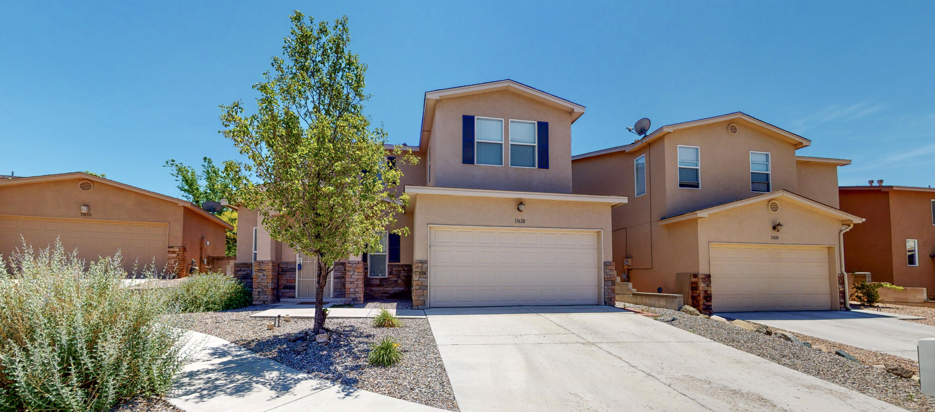 This beautiful home located in the Covered Wagon Subdivision is a must see!! There are two living areas with an open kitchen looking into the dining area.  Home has custom stonework and stainless steel appliances will convey with the home. No HOA and refrigerated air!  This home offers a low maintenance back yard and an open floorpan.   The master is a relaxing retreat with a large walk in closet and separate shower and garden tub.  Conveniently located to I-40, Kirtland AFB, grocery stores, movie theater and much more.  Schedule your showing; you won't want to miss this gem in Four Hills Area.